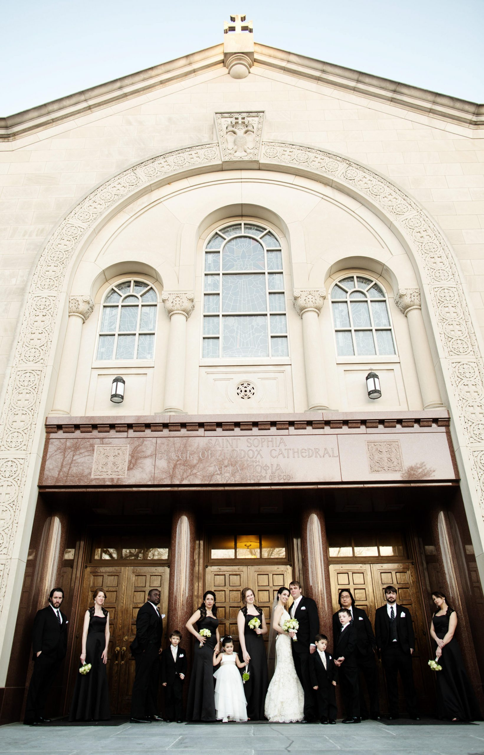 St. Sophia Greek Orthodox Cathedral Wedding  I  The wedding party poses in front of the cathedral in Washington, DC.