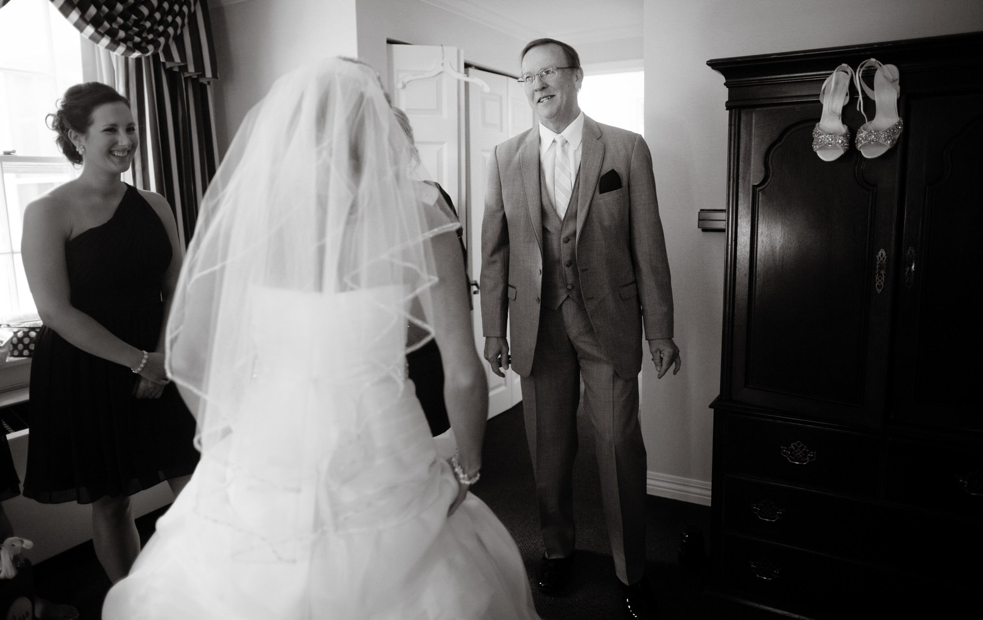 The father of the bride sees his daughter before the ceremony.