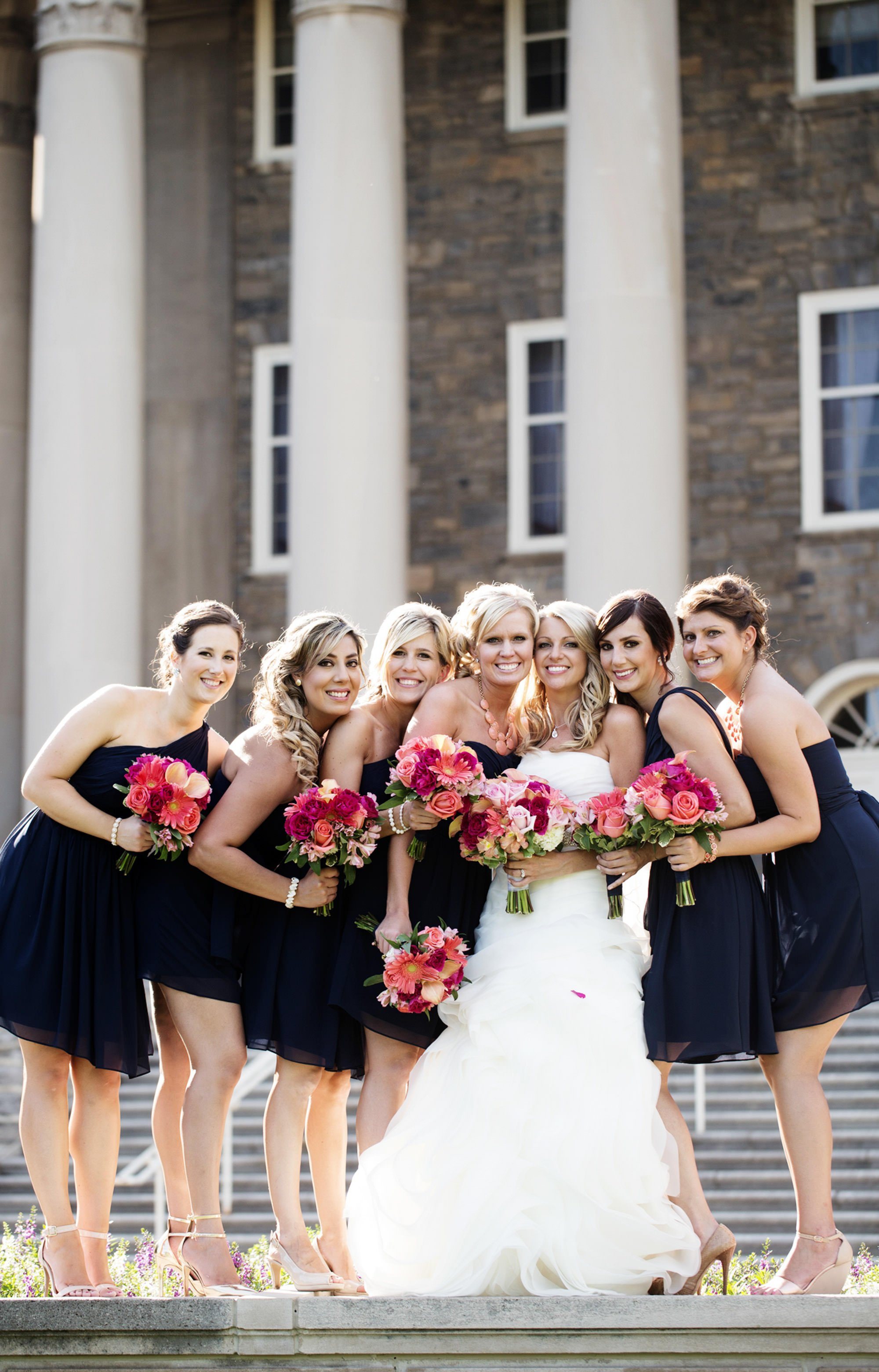 The bridal party poses on the steps of Old Main on the Penn State University campus in State College.