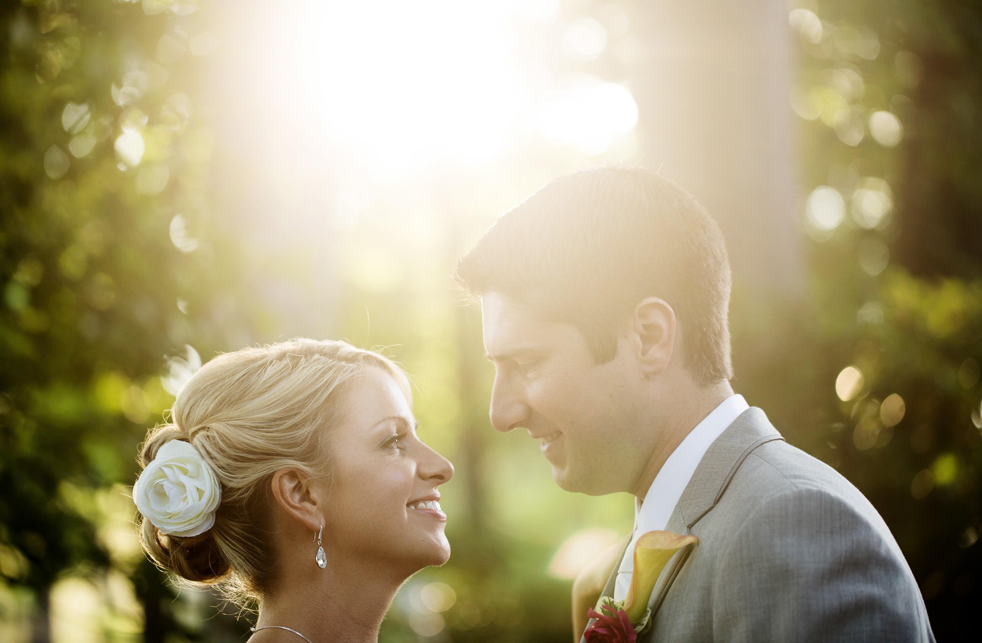 The bride and groom smile during sunset at their Nittany Lion Inn wedding.
