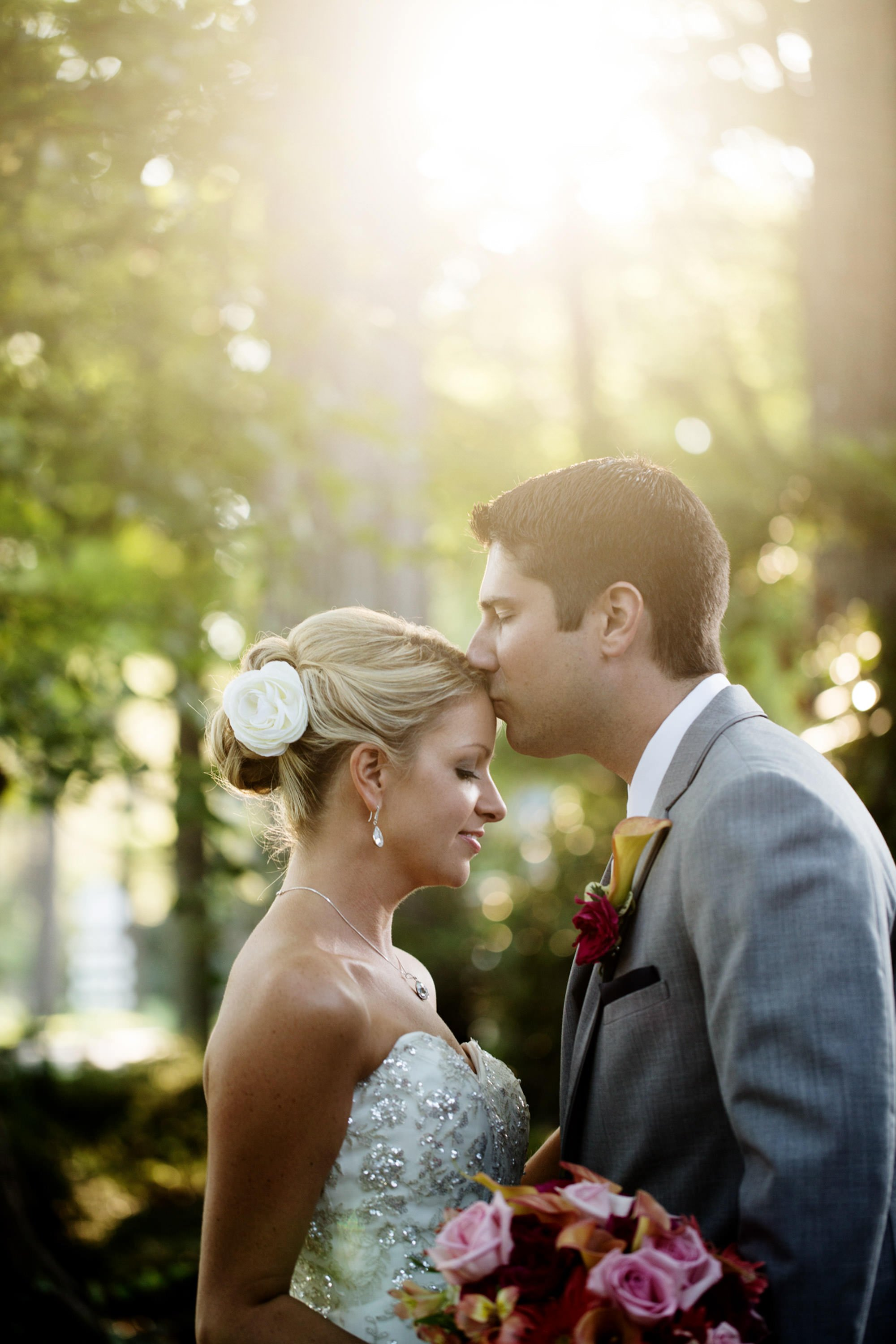 The bride and groom pose during sunset on their wedding day at Nittany Lion Inn.