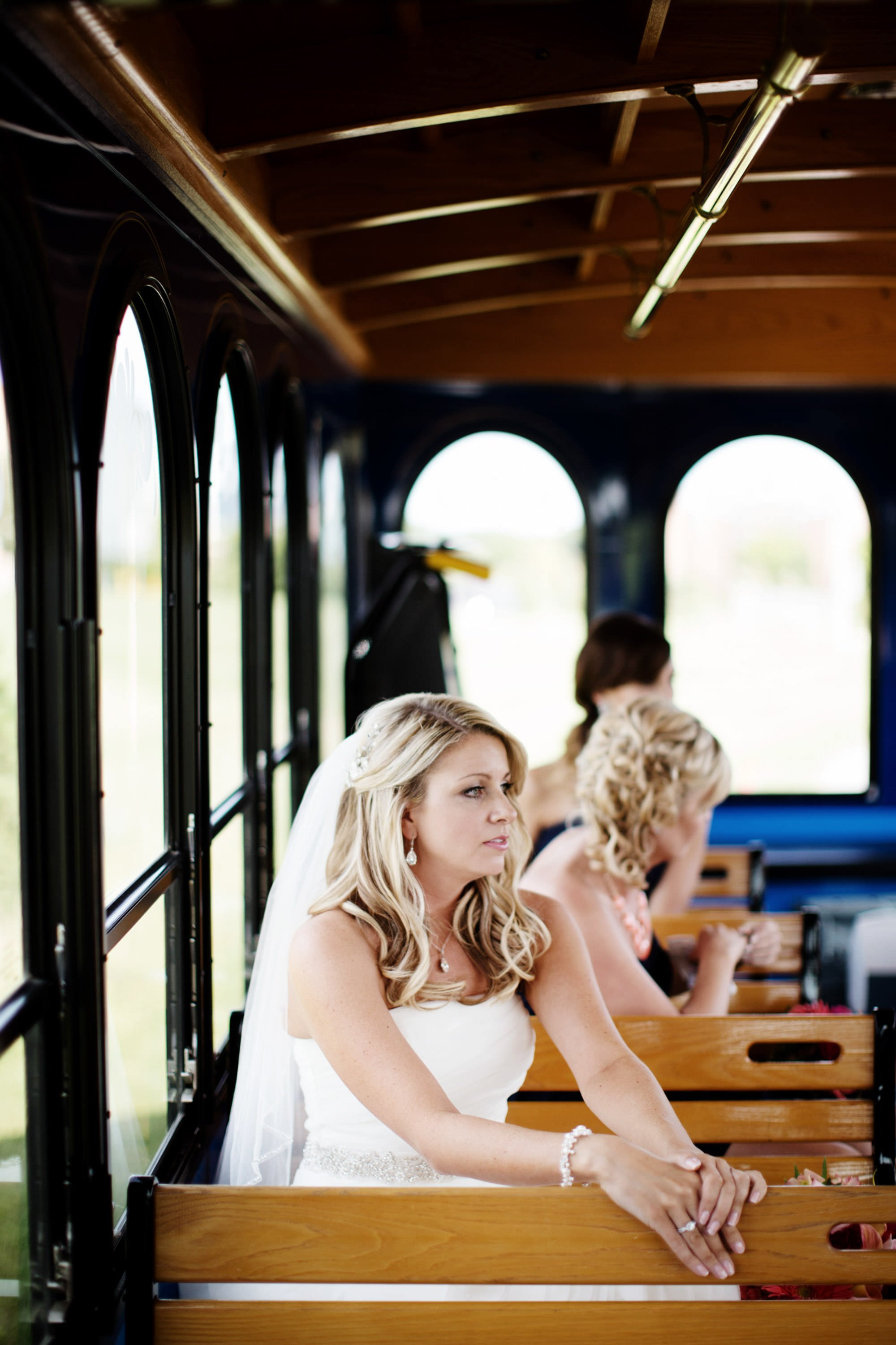 The bridal party takes a trolley to the ceremony site at Penn State University.