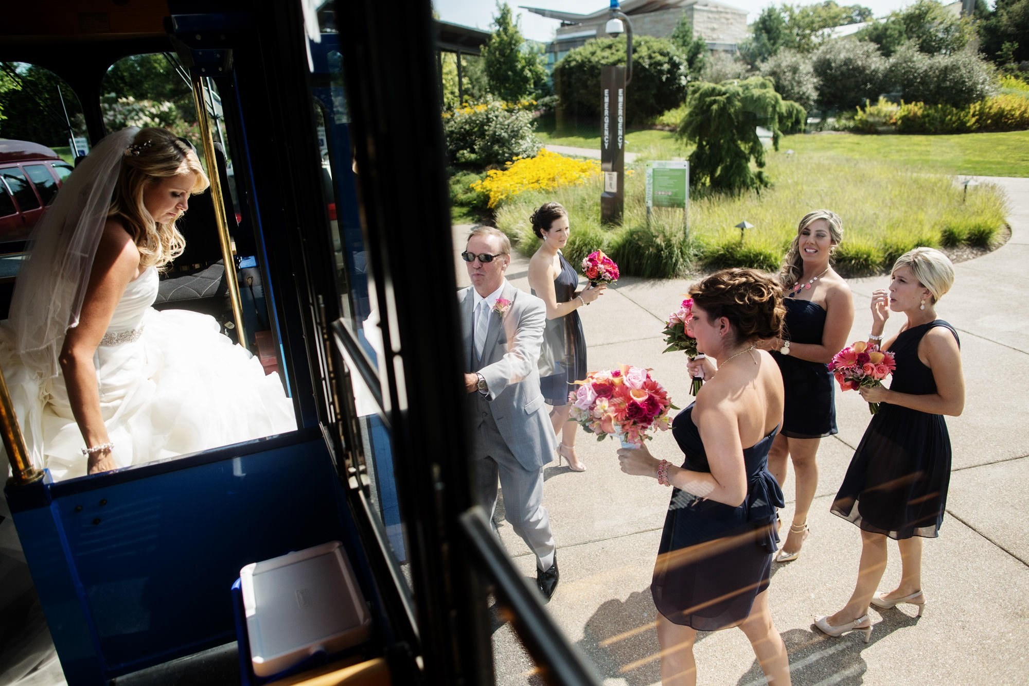 The bride leaves the trolley before the wedding ceremony at the Penn State Arboretum.
