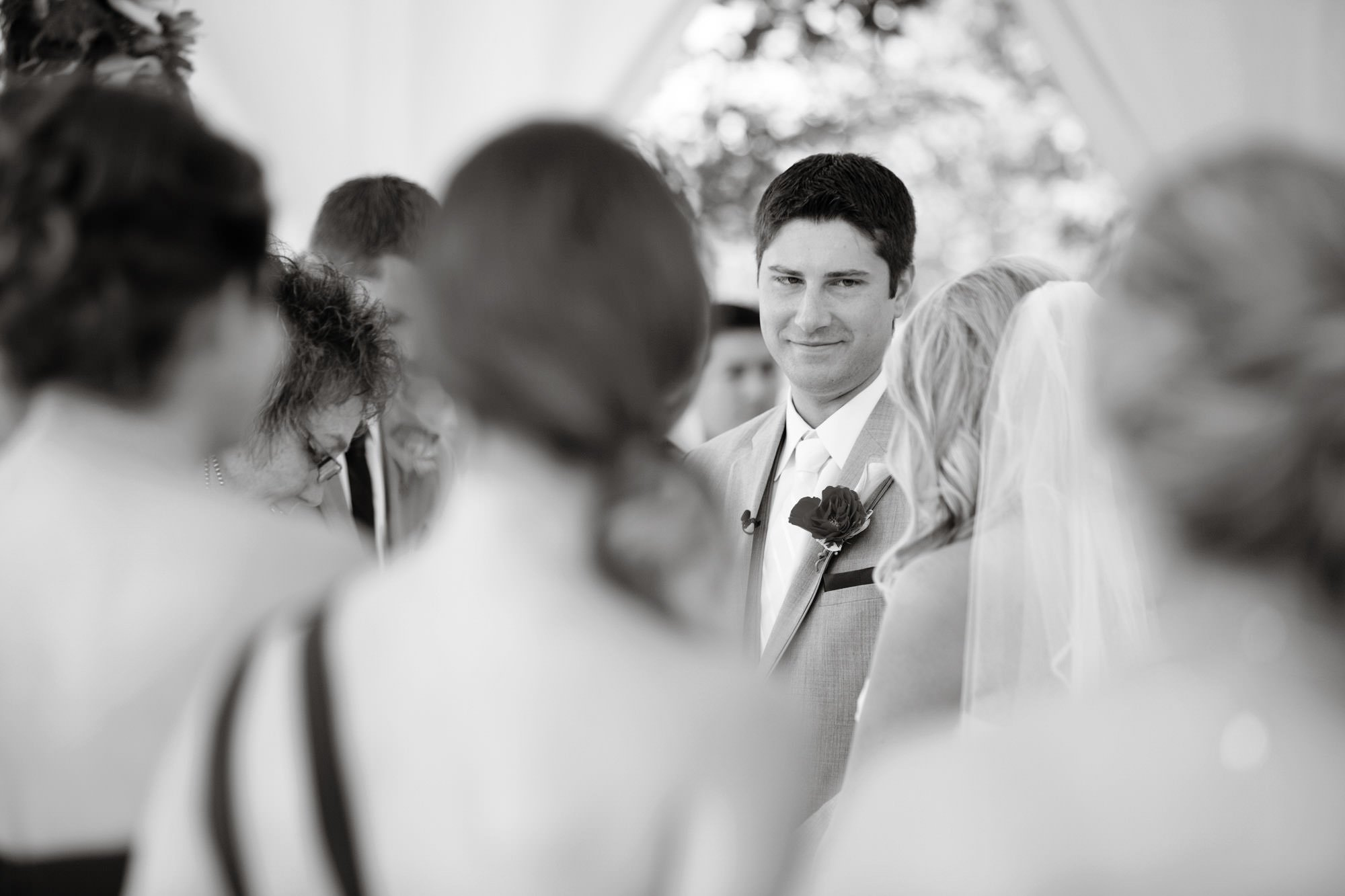 The groom looks at his bride during the wedding ceremony.