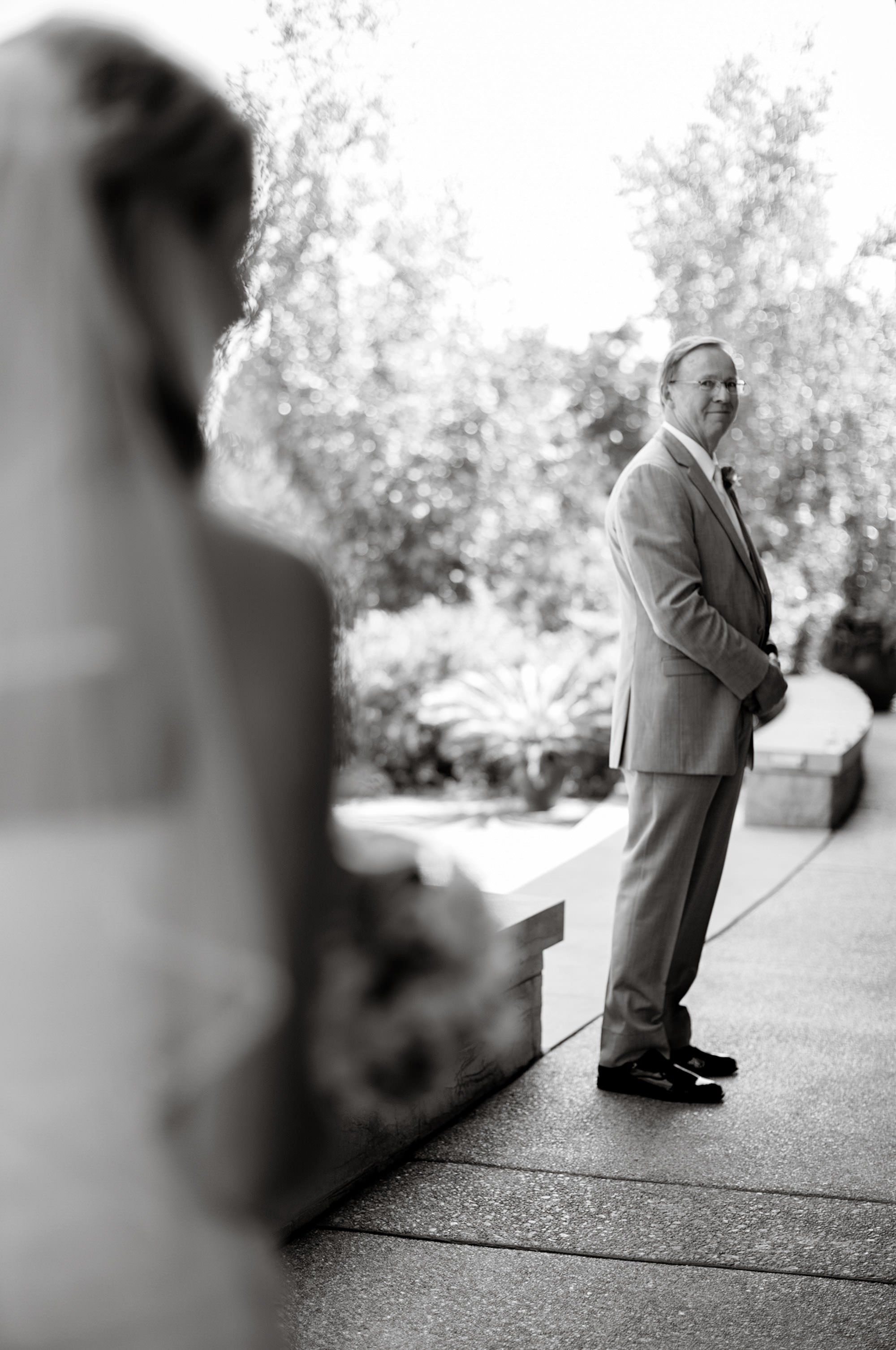 The father of the bride looks at his daughter before the Penn State Arboretum wedding.
