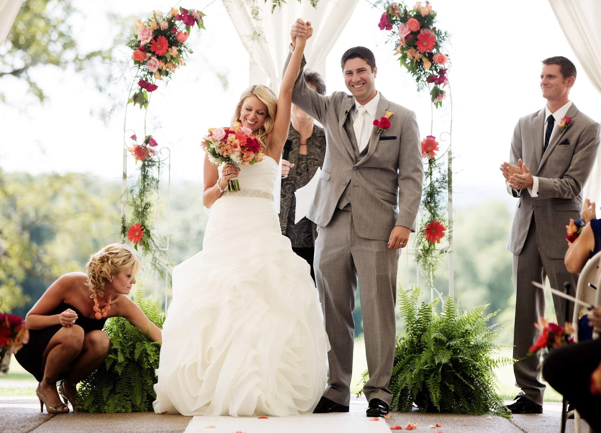 The couple cheers following their Penn State Arboretum wedding.