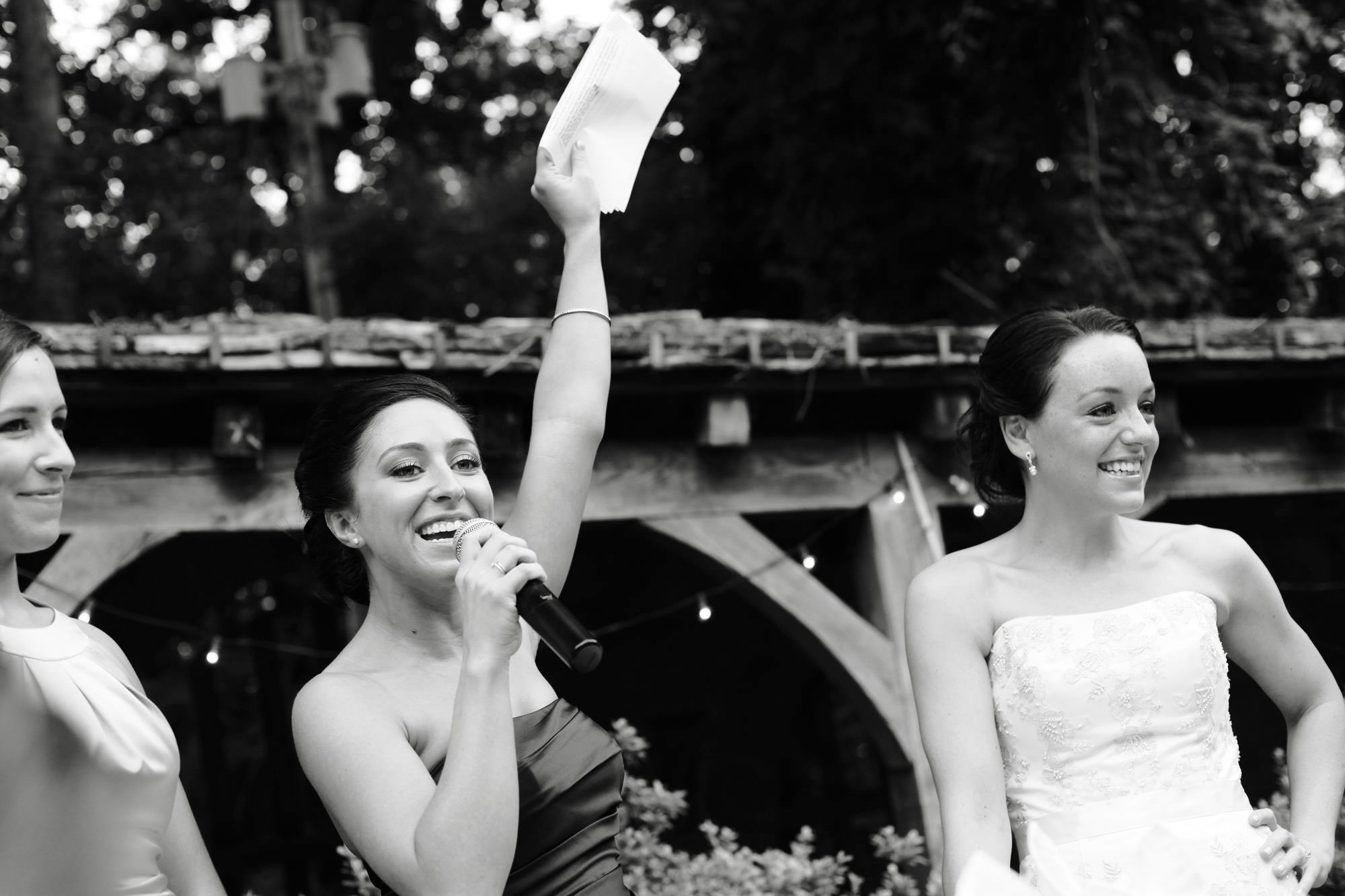 Cloisters Castle Wedding  I  The maid of honor gives a toast during the wedding reception.