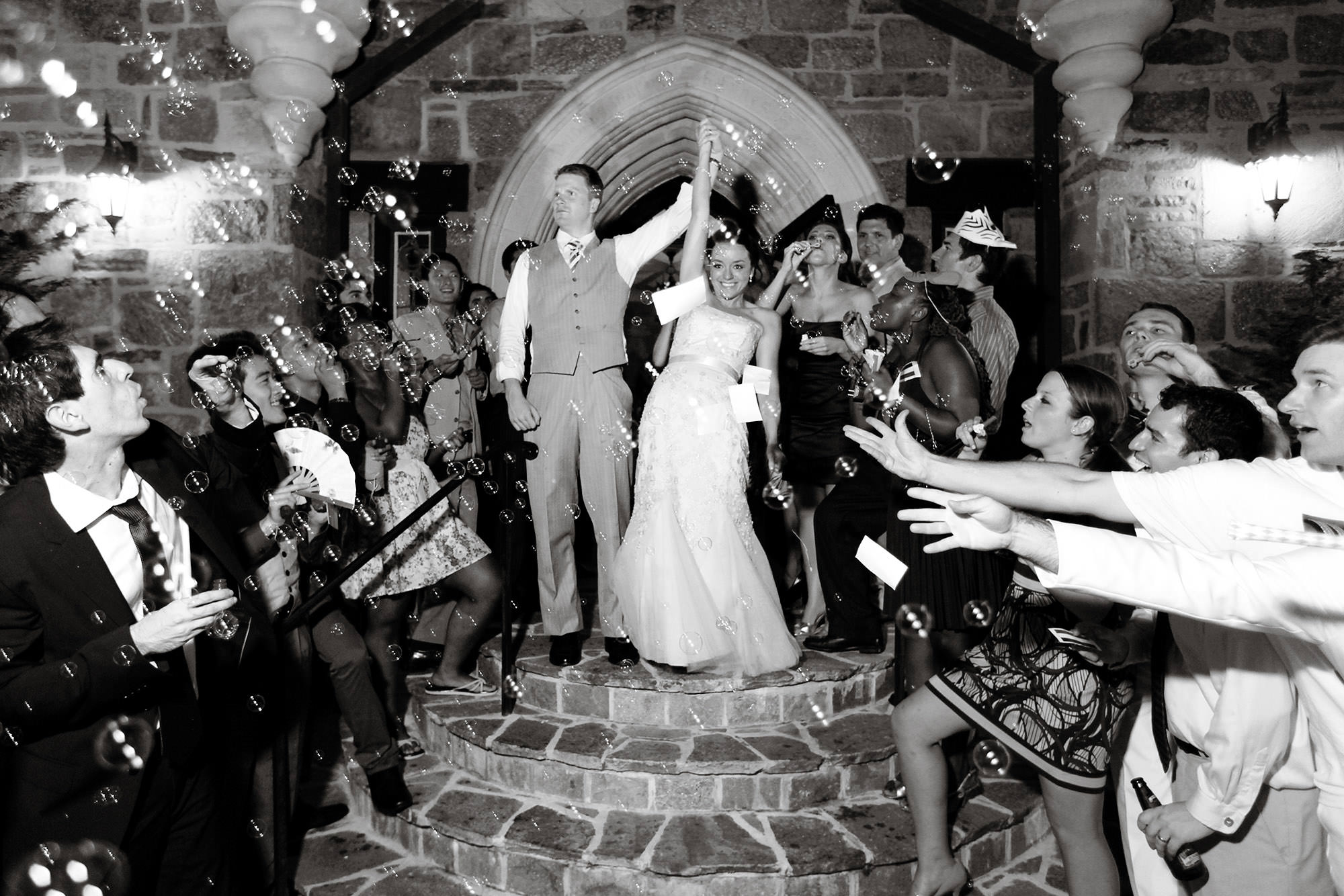 Cloisters Castle Wedding  I  The bride and groom cheer during their sendoff following the wedding reception.