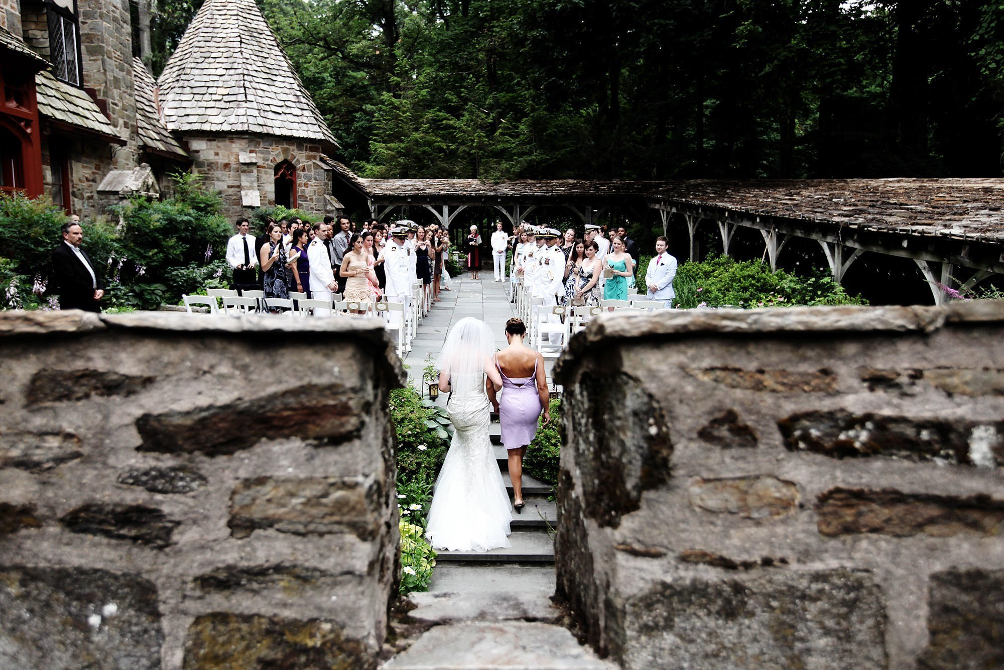 Cloisters Castle Wedding  I  The bride processes down the aisle with her mother during the ceremony in Lutherville, MD.