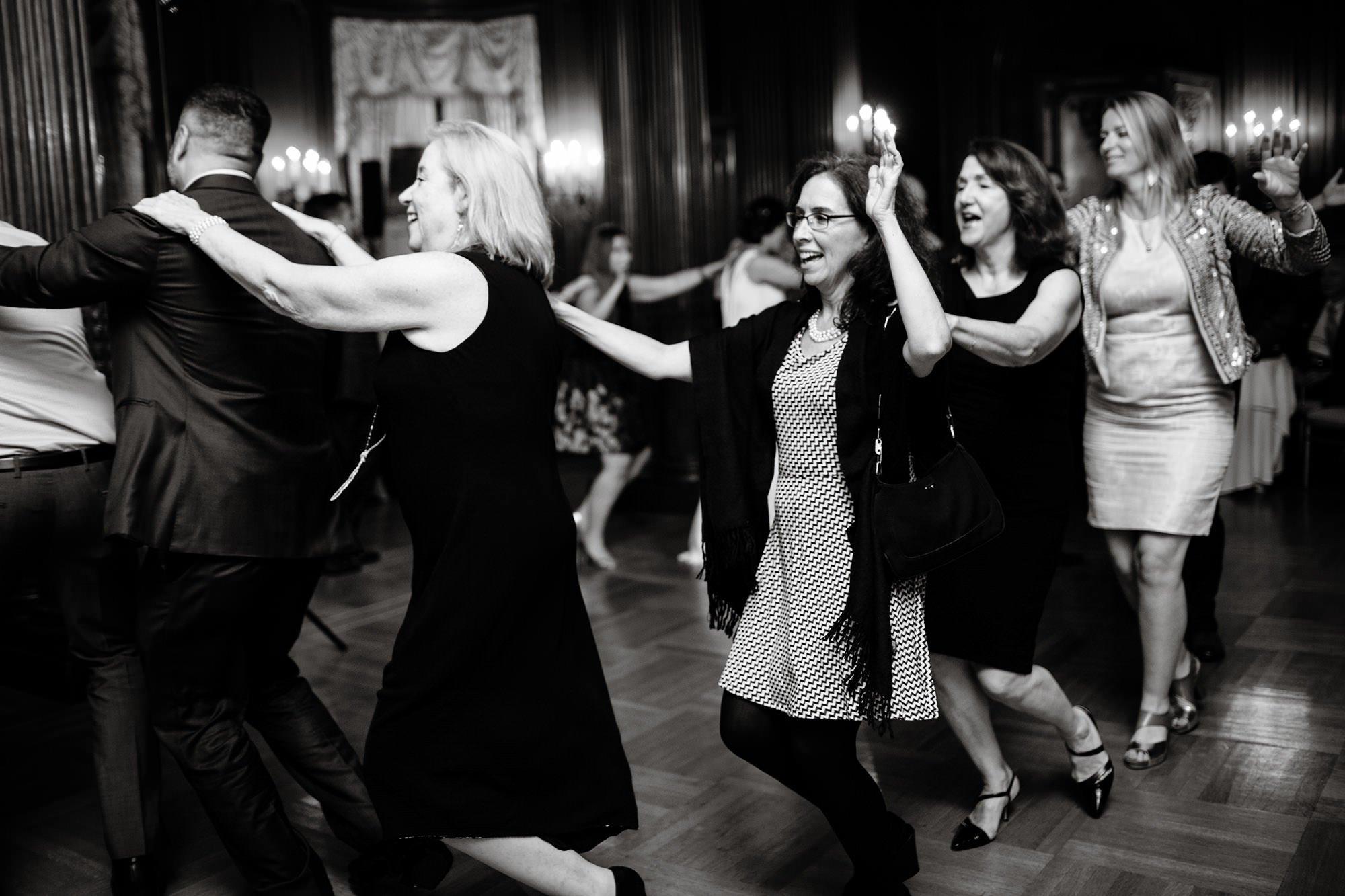 Guests enjoy the wedding reception at Cosmos Club in Washington, DC.