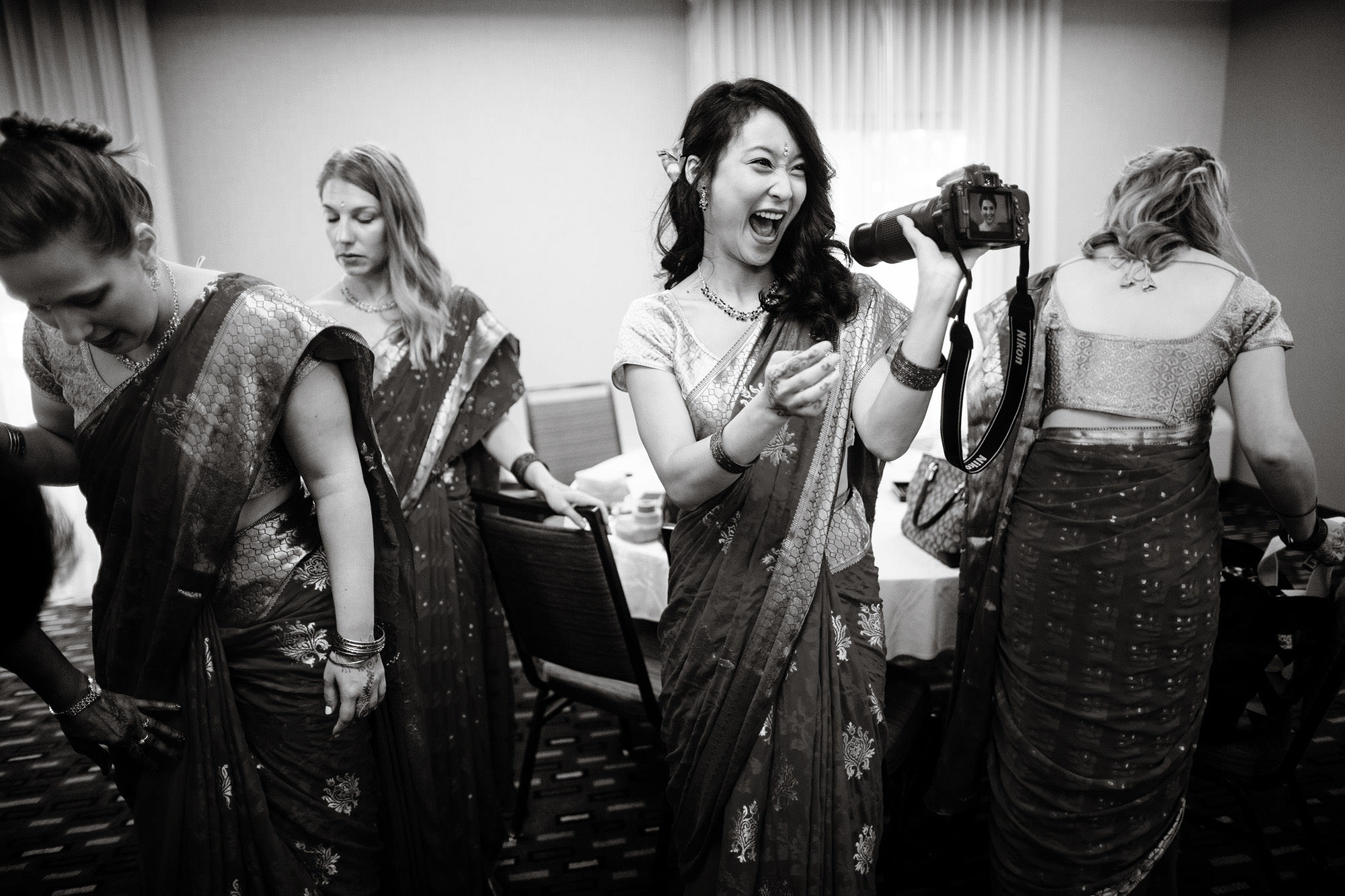 Bridesmaids get ready prior to the Hindu ceremony at Foxchase Manor.