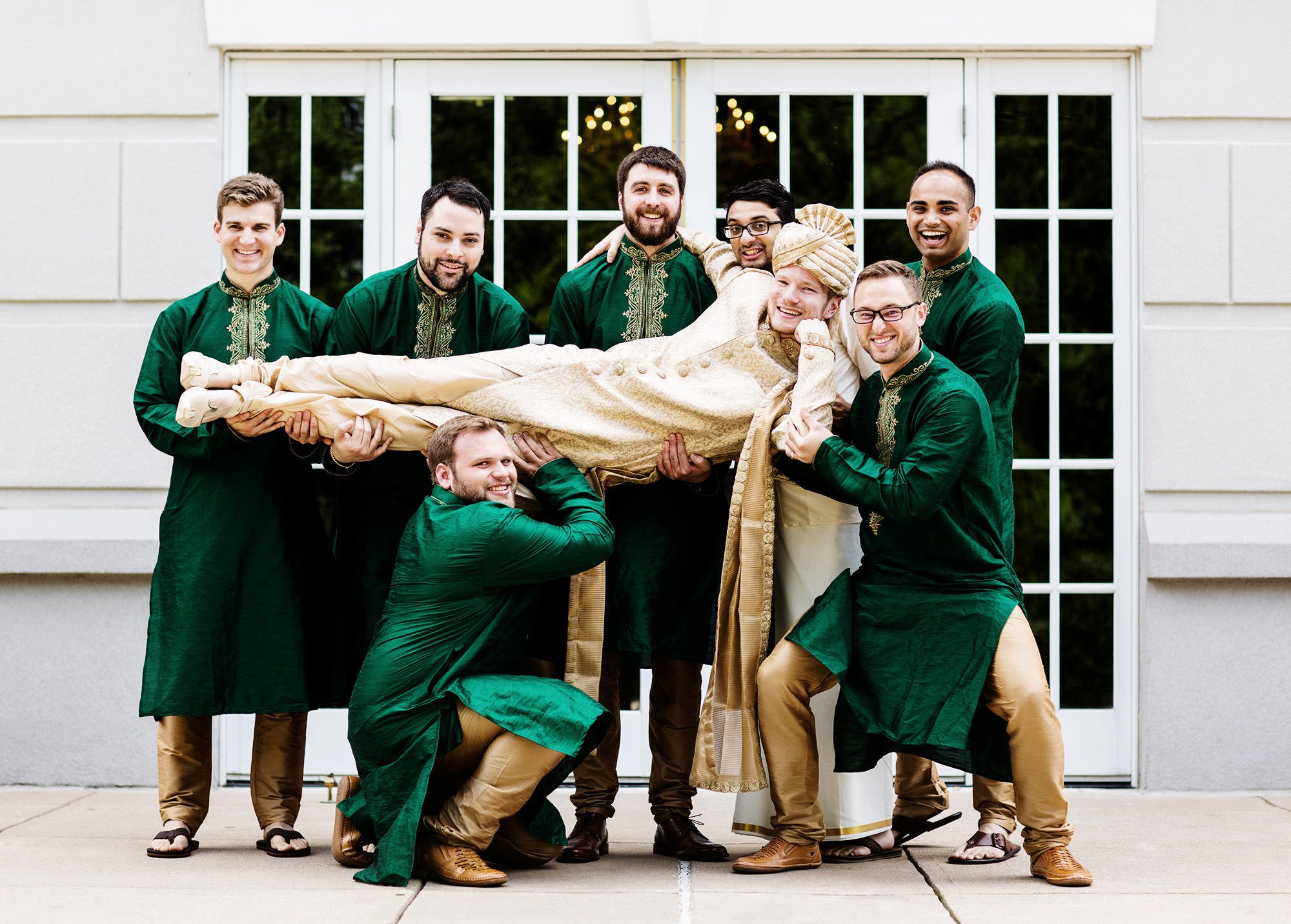 A groomsmen portrait on the patio of Foxchase Manor.