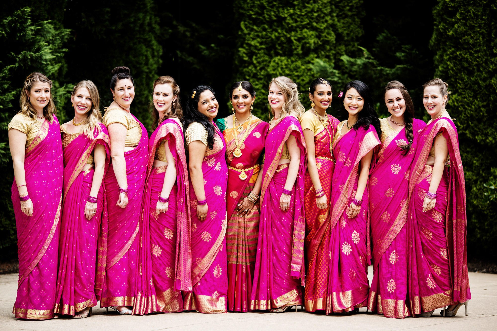A portrait of bridesmaids wearing Indian dresses.