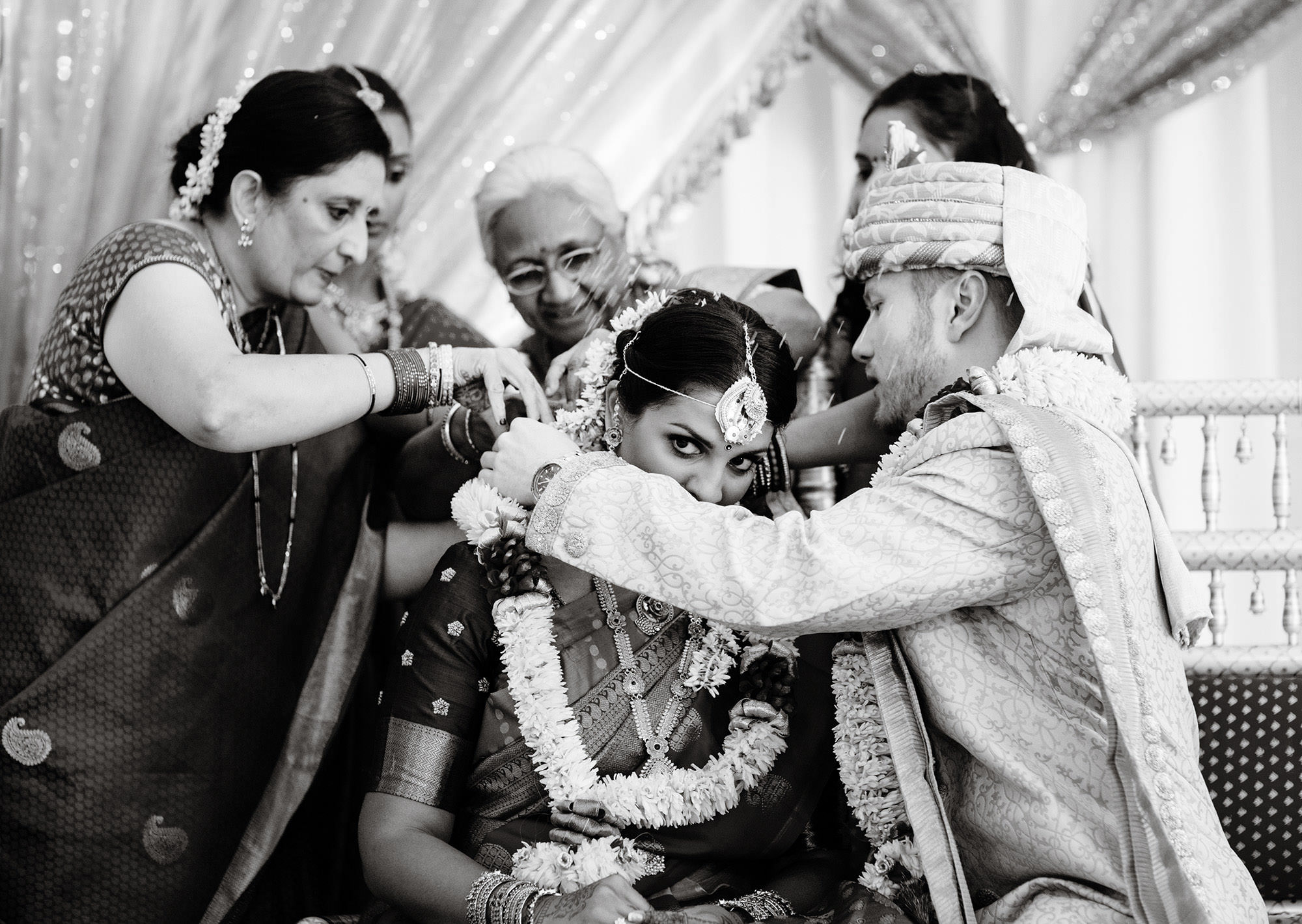 The Bride and Groom participate in a  Hindu Ceremony at Foxchase Manor.
