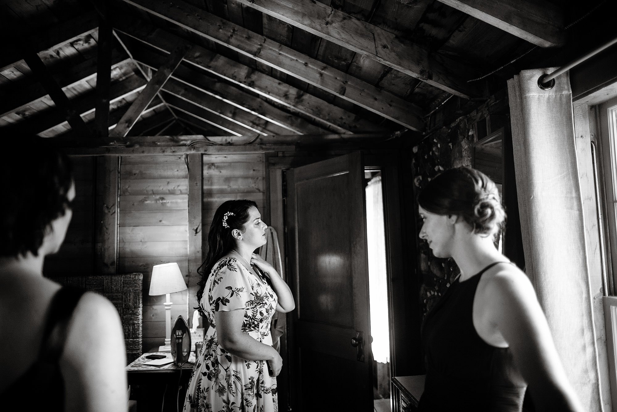 The bride gets ready prior to her Hulbert Outdoor Center wedding.