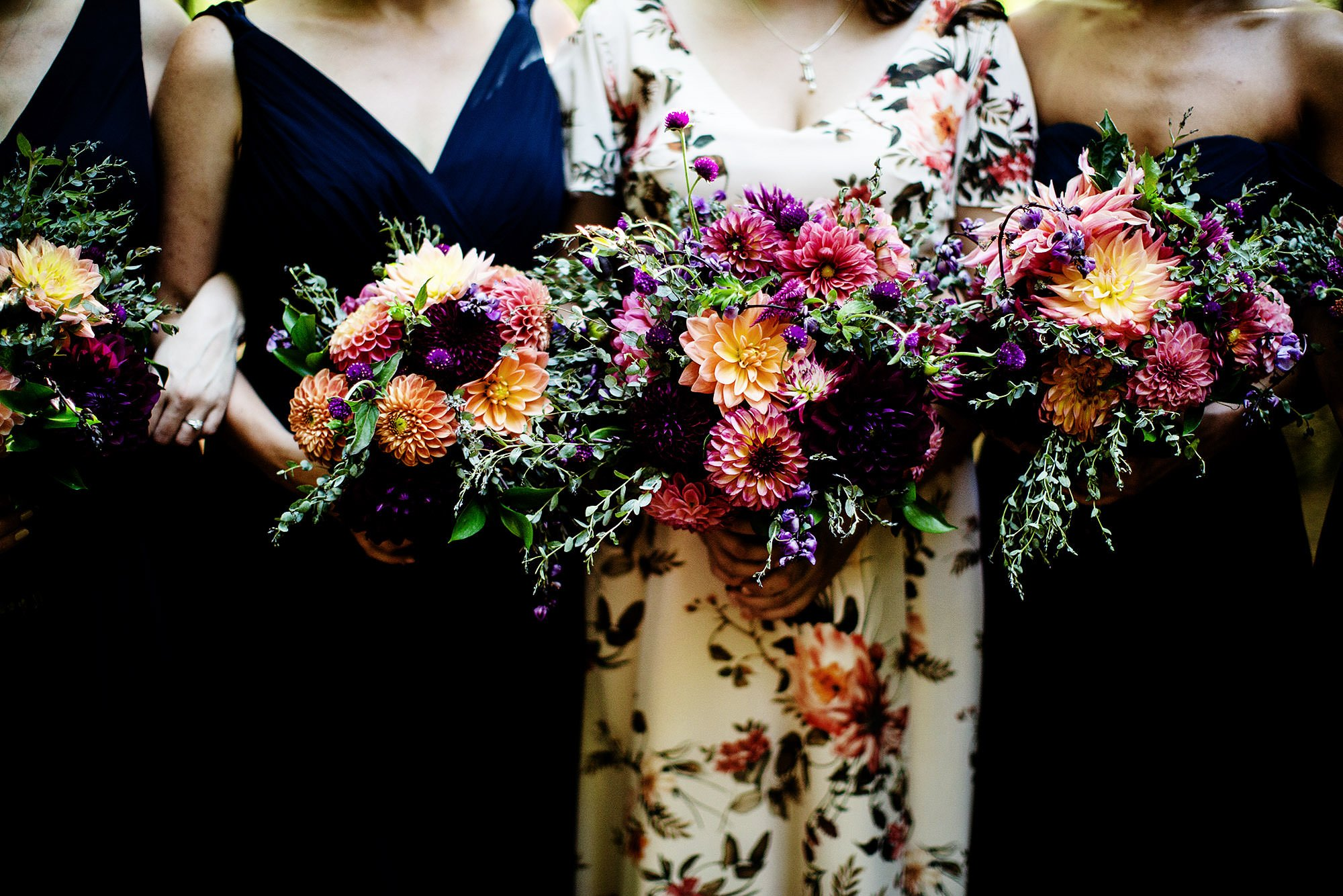 Bridesmaids show off their DIY bouquets during their Hulbert Outdoor Center wedding.