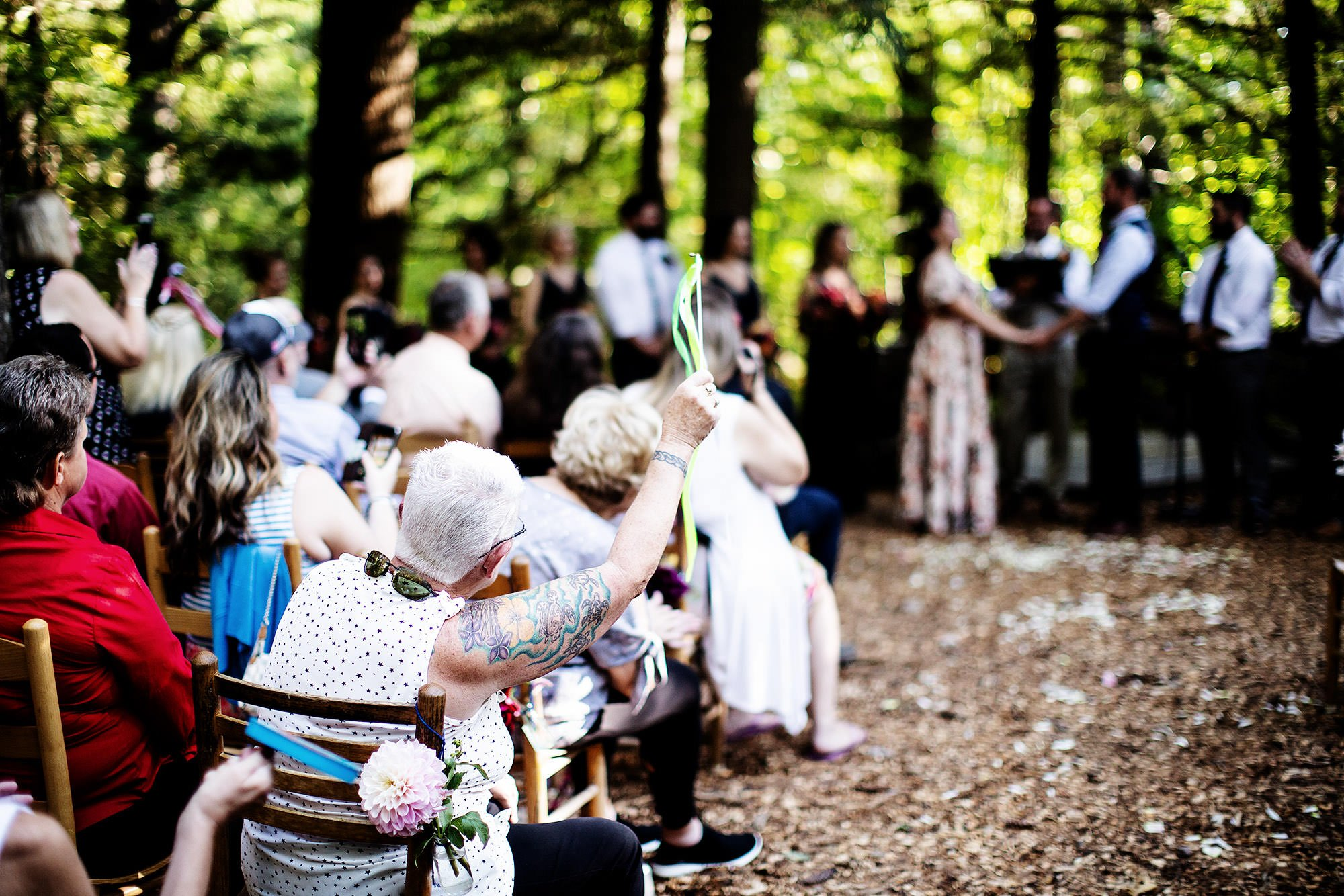 Guests celebrate during the wedding ceremony at Hulbert Outdoor Center.