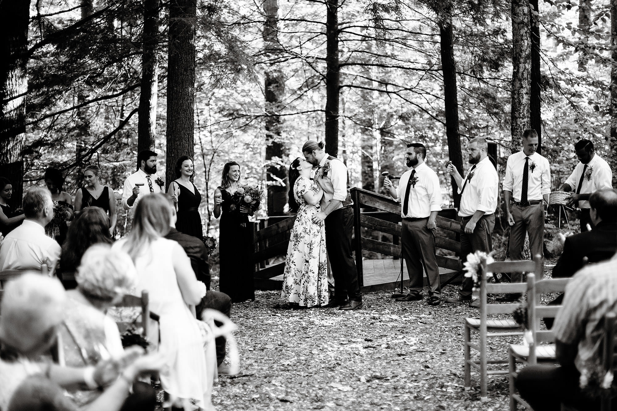 The bride and groom share their first kiss following the ceremony during their Hulbert Outdoor Center wedding.
