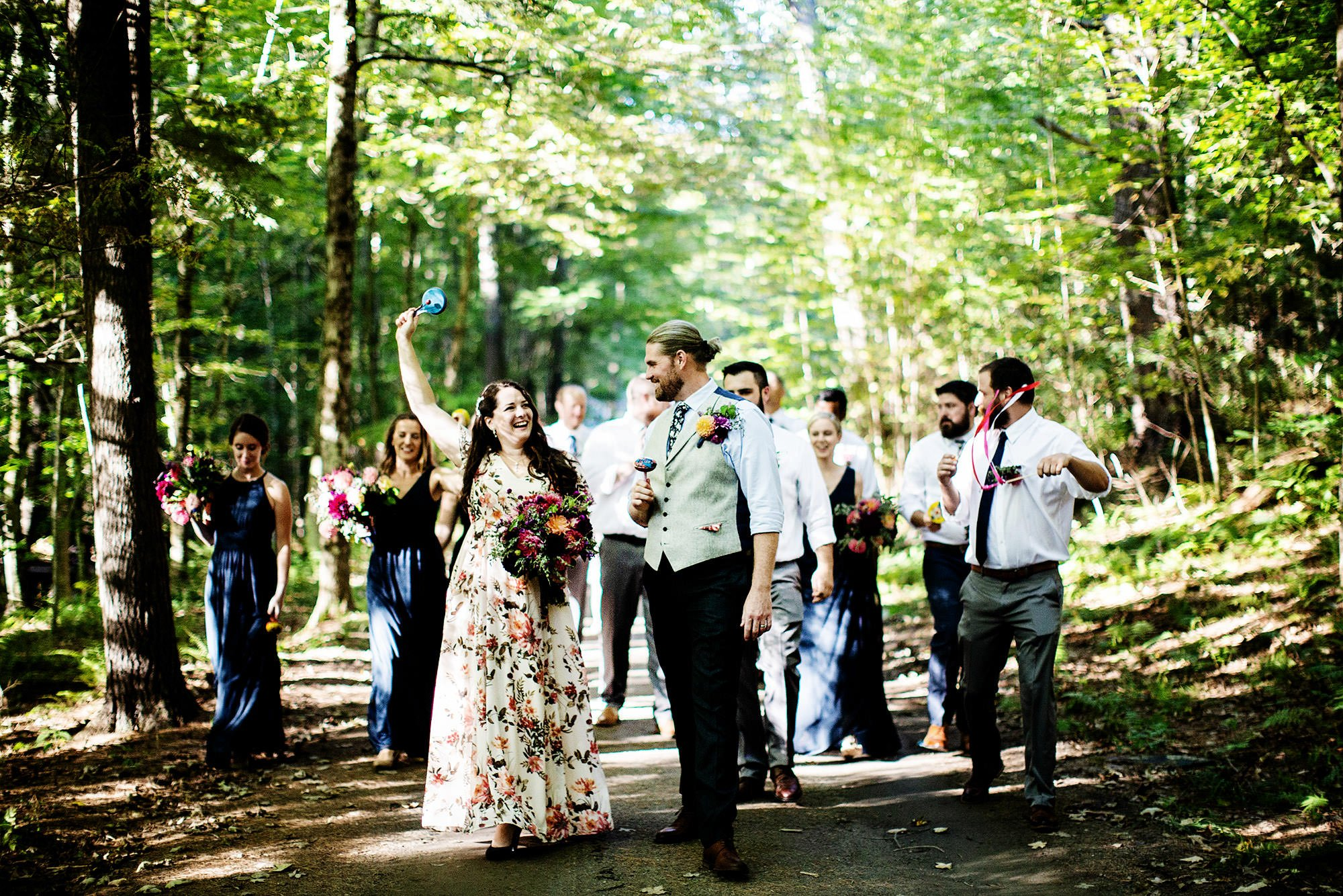 The wedding party cheers following the ceremony at Hulbert Outdoor Center.