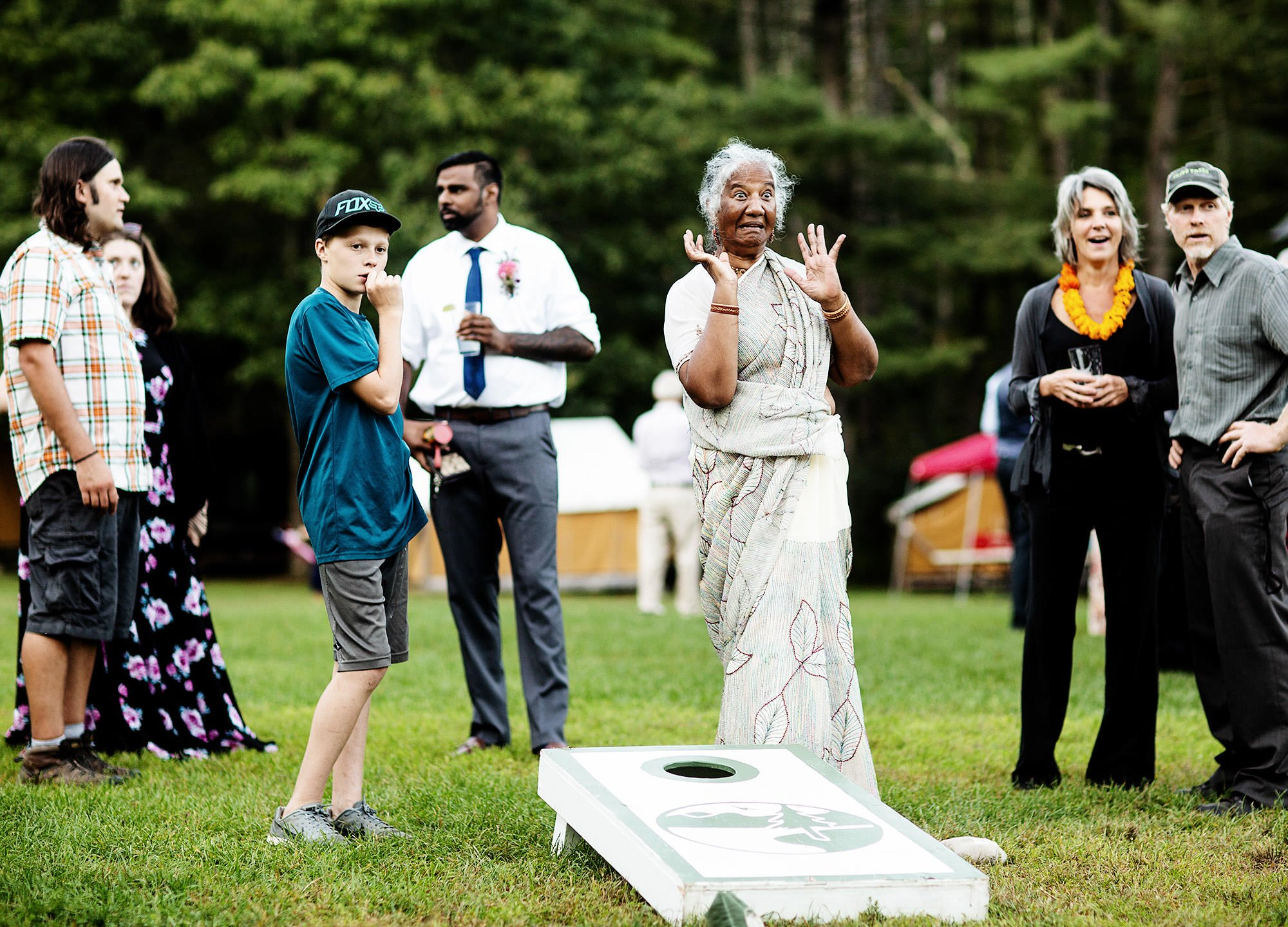 Guest play corn hole during cocktail hour at Hulbert Outdoor Center.