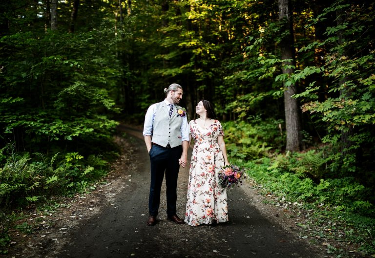 The Bride and Groom pose for a a portrait during their Hulbert Outdoor Center Wedding in Fairlee, VT.