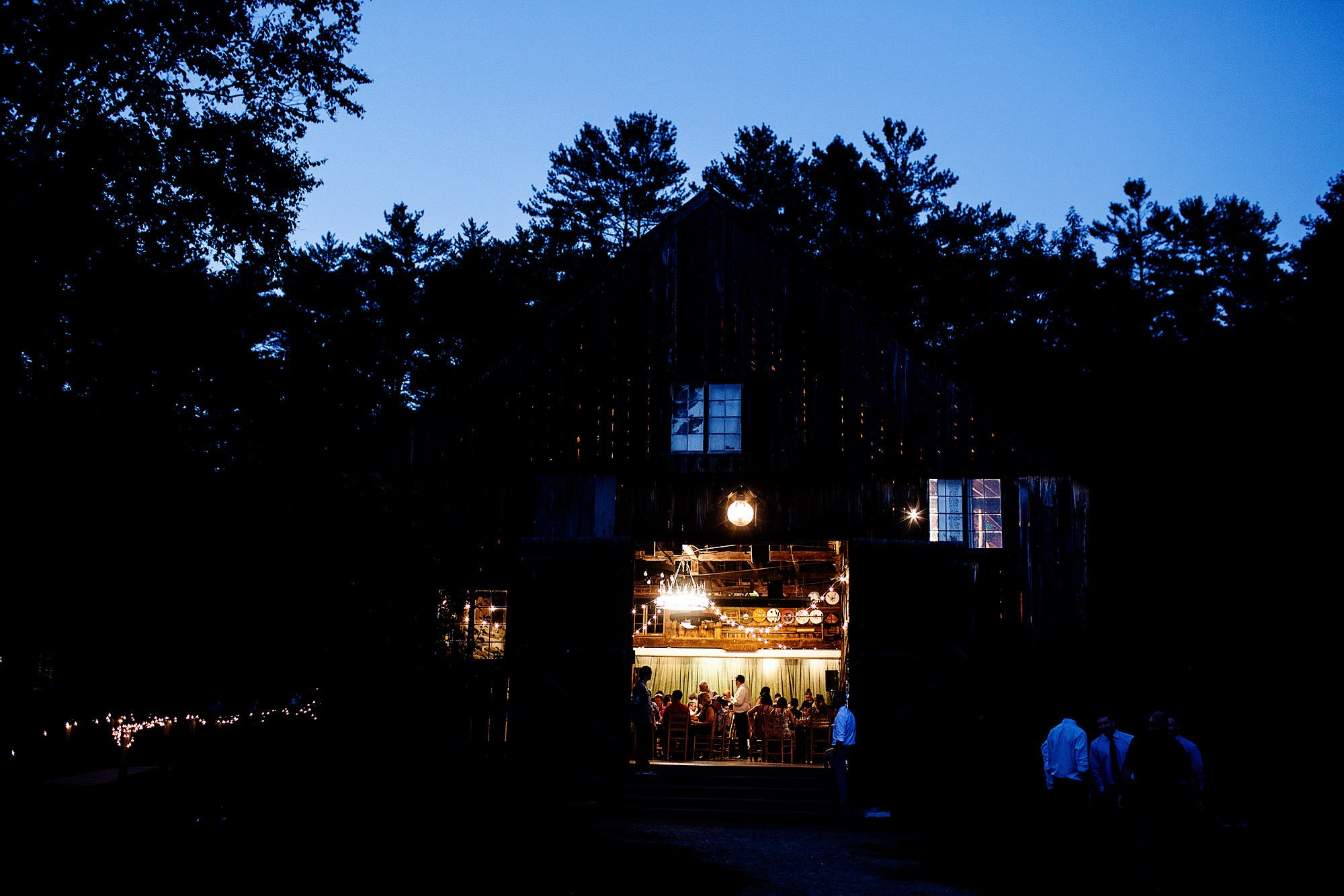 The wedding reception in the barn during this Hulbert Outdoor Center wedding.