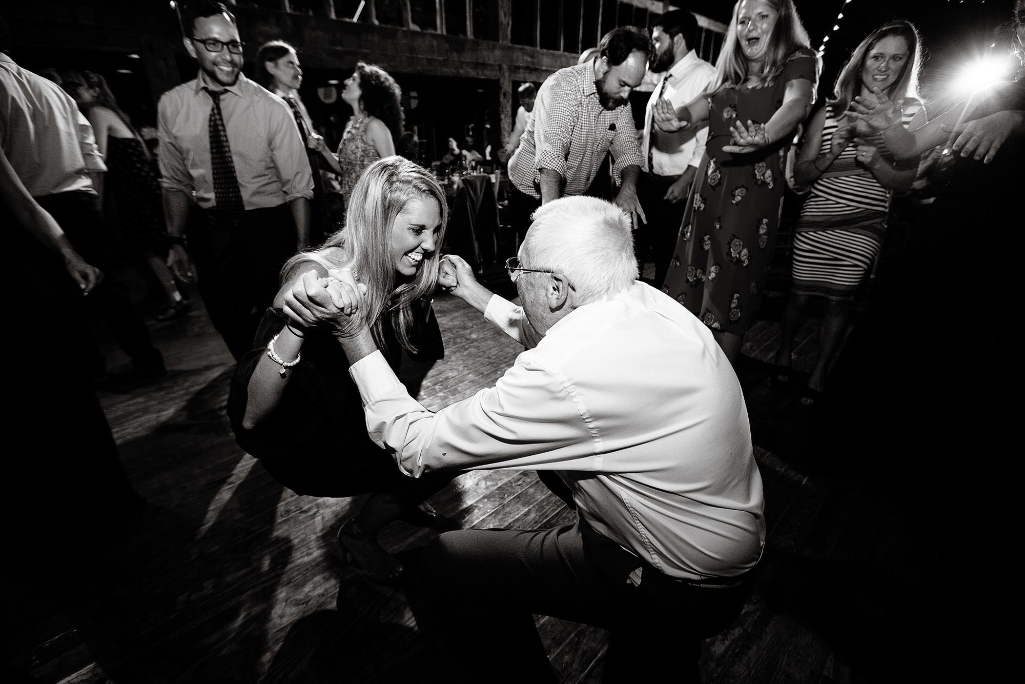 Guests dance in the barn during the wedding reception at Hulbert Outdoor Center.