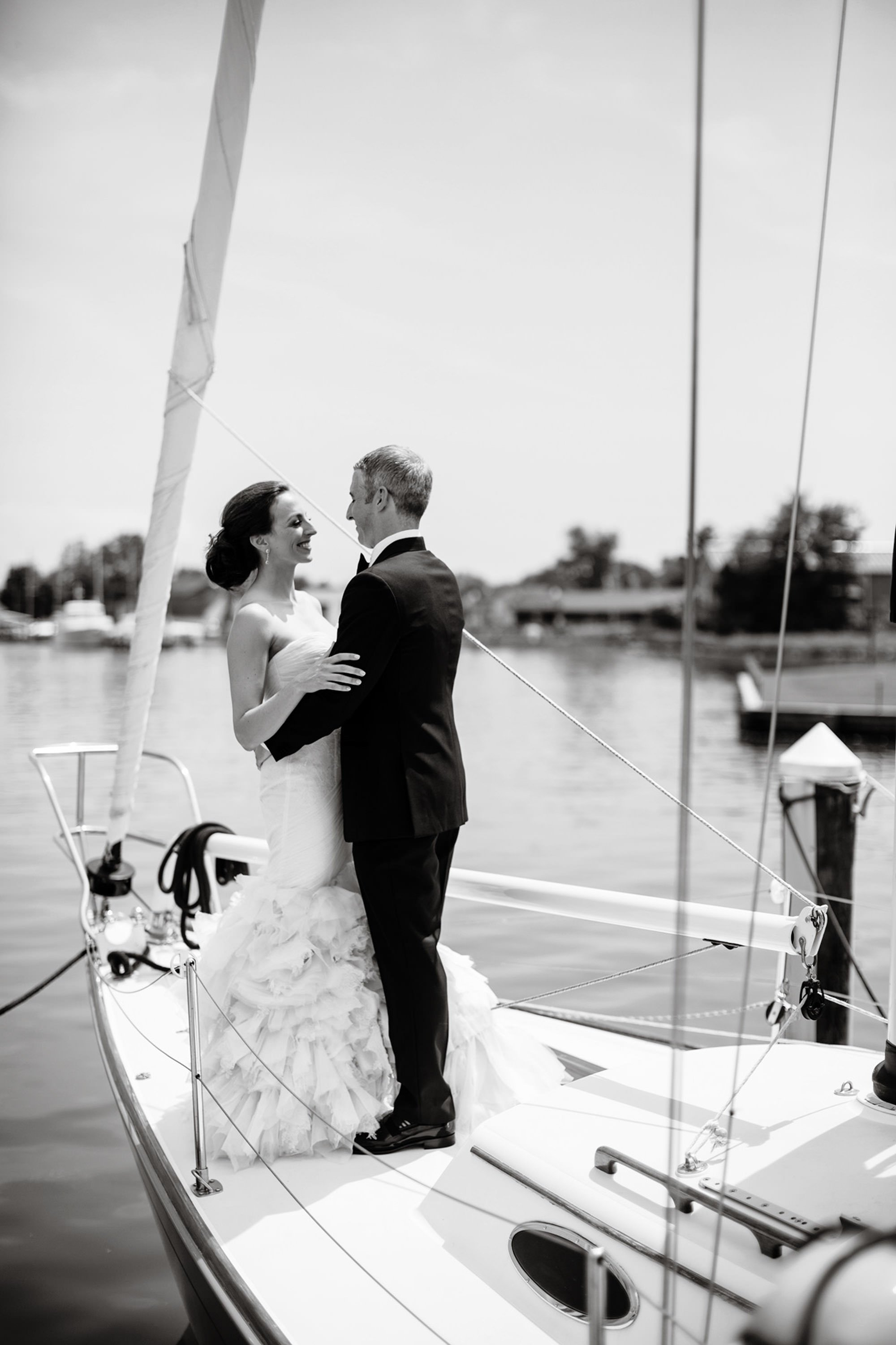 A portrait of the bride and groom on a boat.