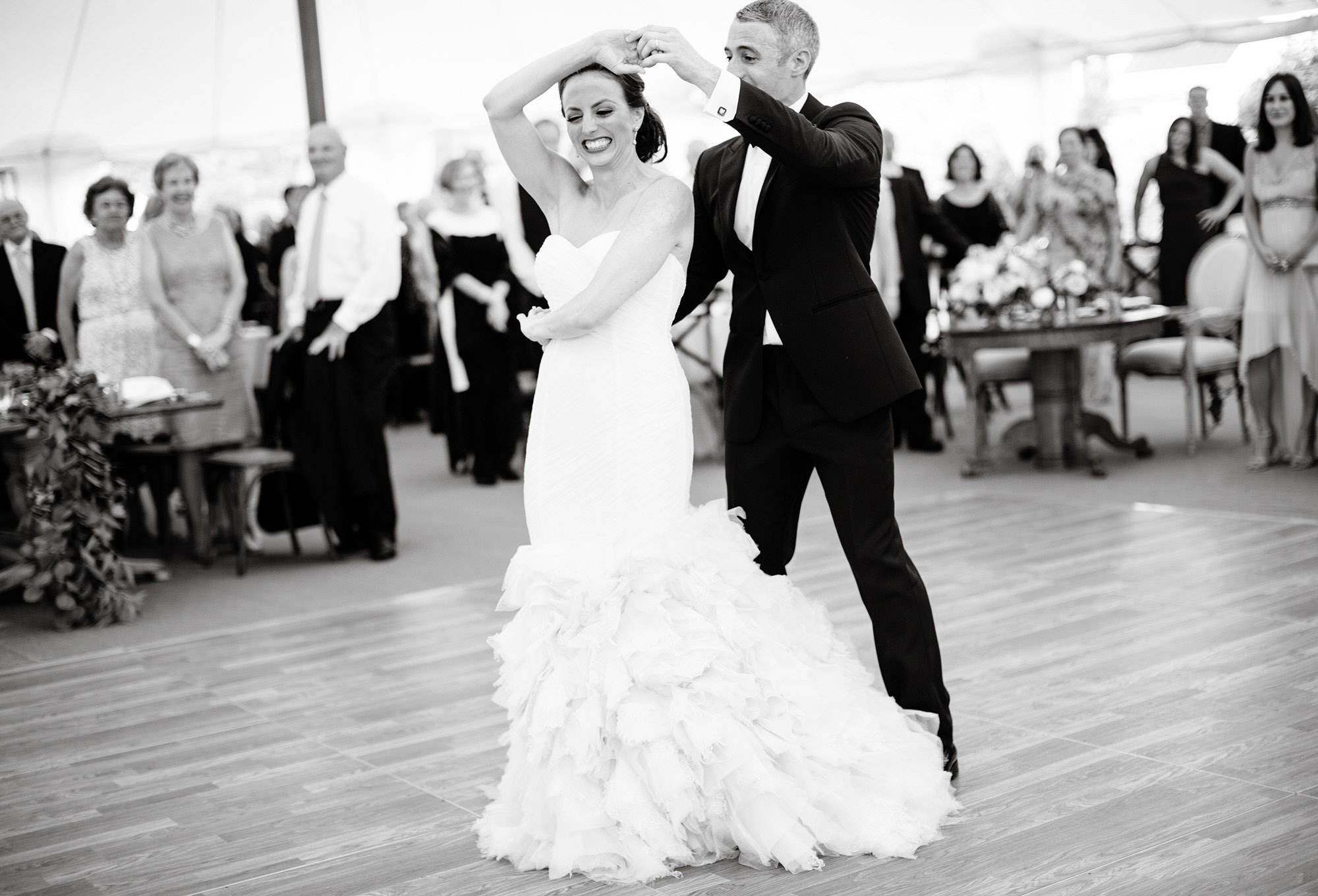 The Bride and Groom enjoy their First Dance during their wedding reception.