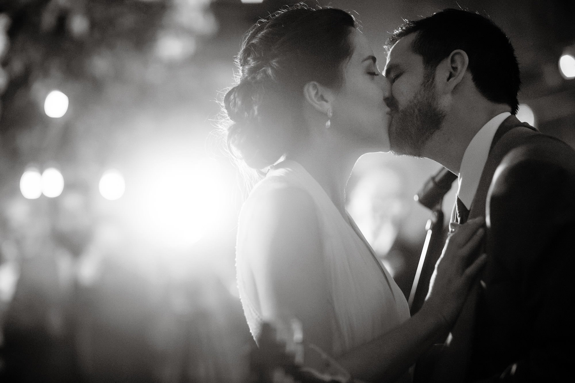 The Bride and Groom Kiss During the Reception at Longview Gallery.