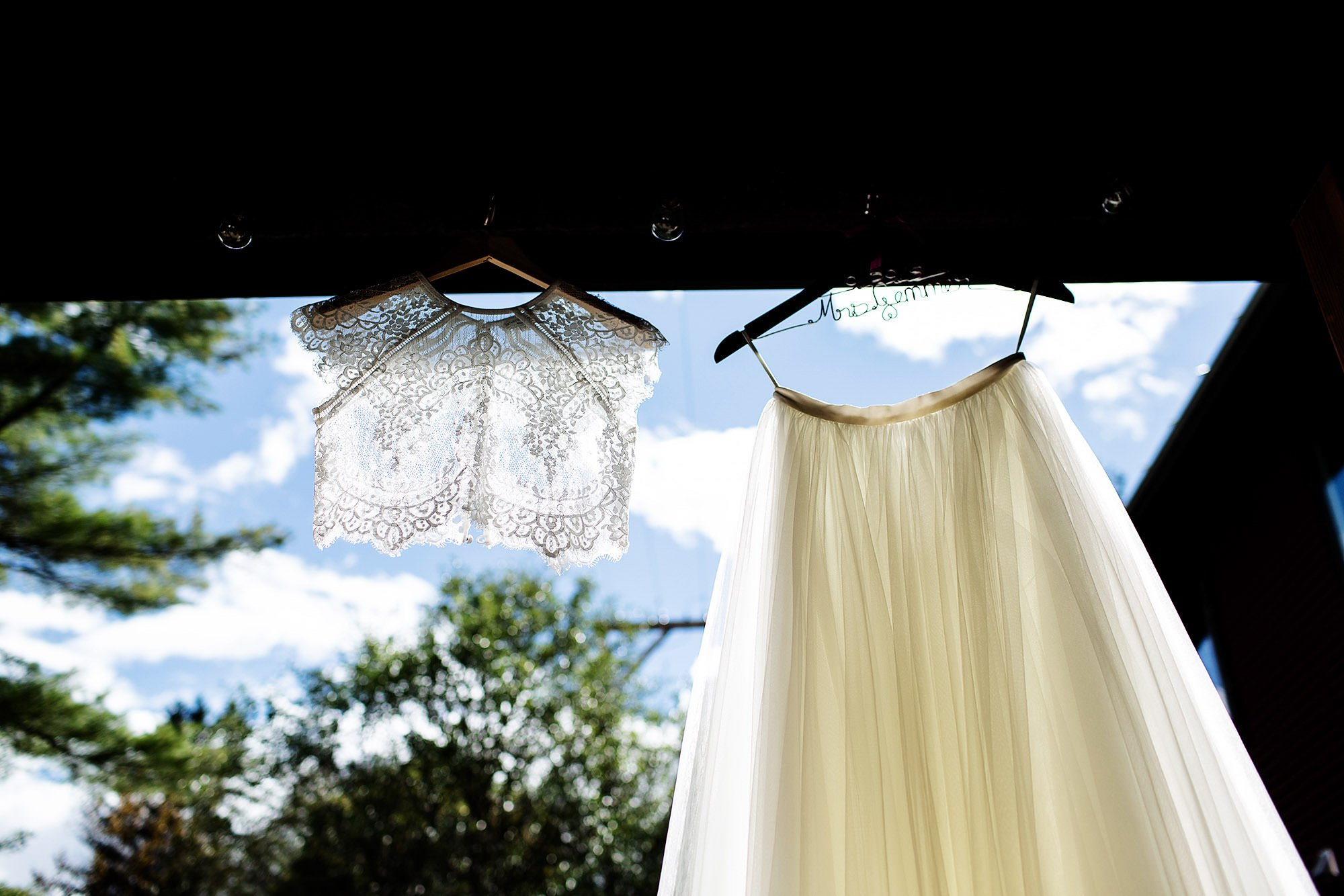 A detail of the bride's dress at Mad River Barn.