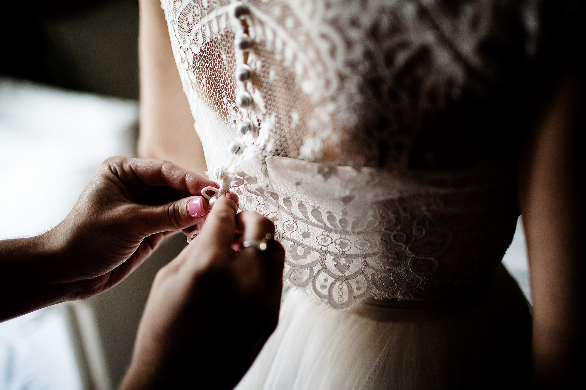 The bride puts on her wedding dress.