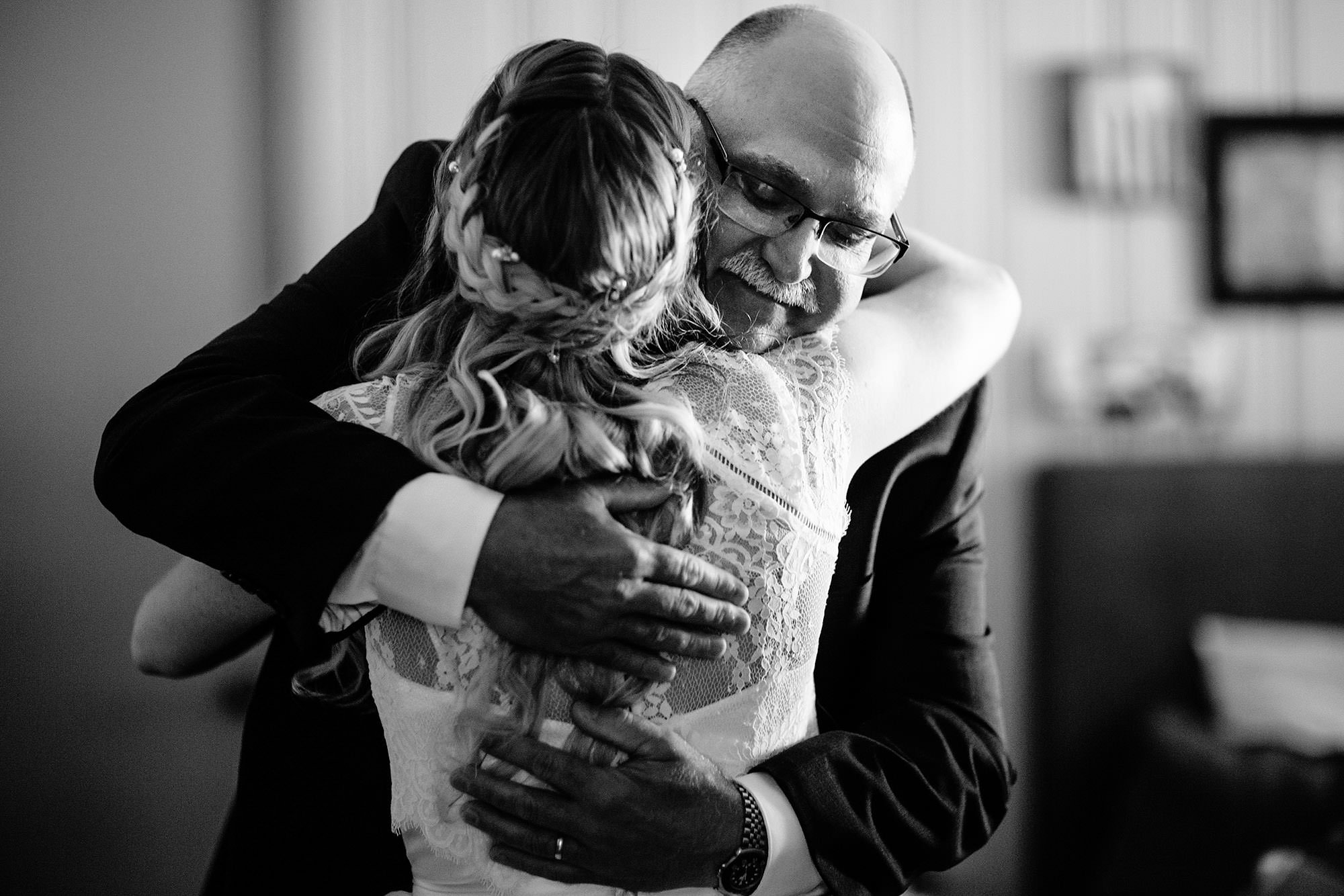 The father of the bride hugs his daughter prior to the ceremony at Mad River Barn.