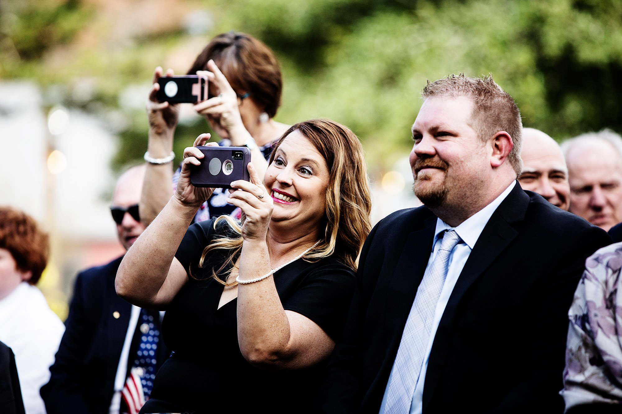 Guests use their cameras during the wedding ceremony at Mad River Barn.