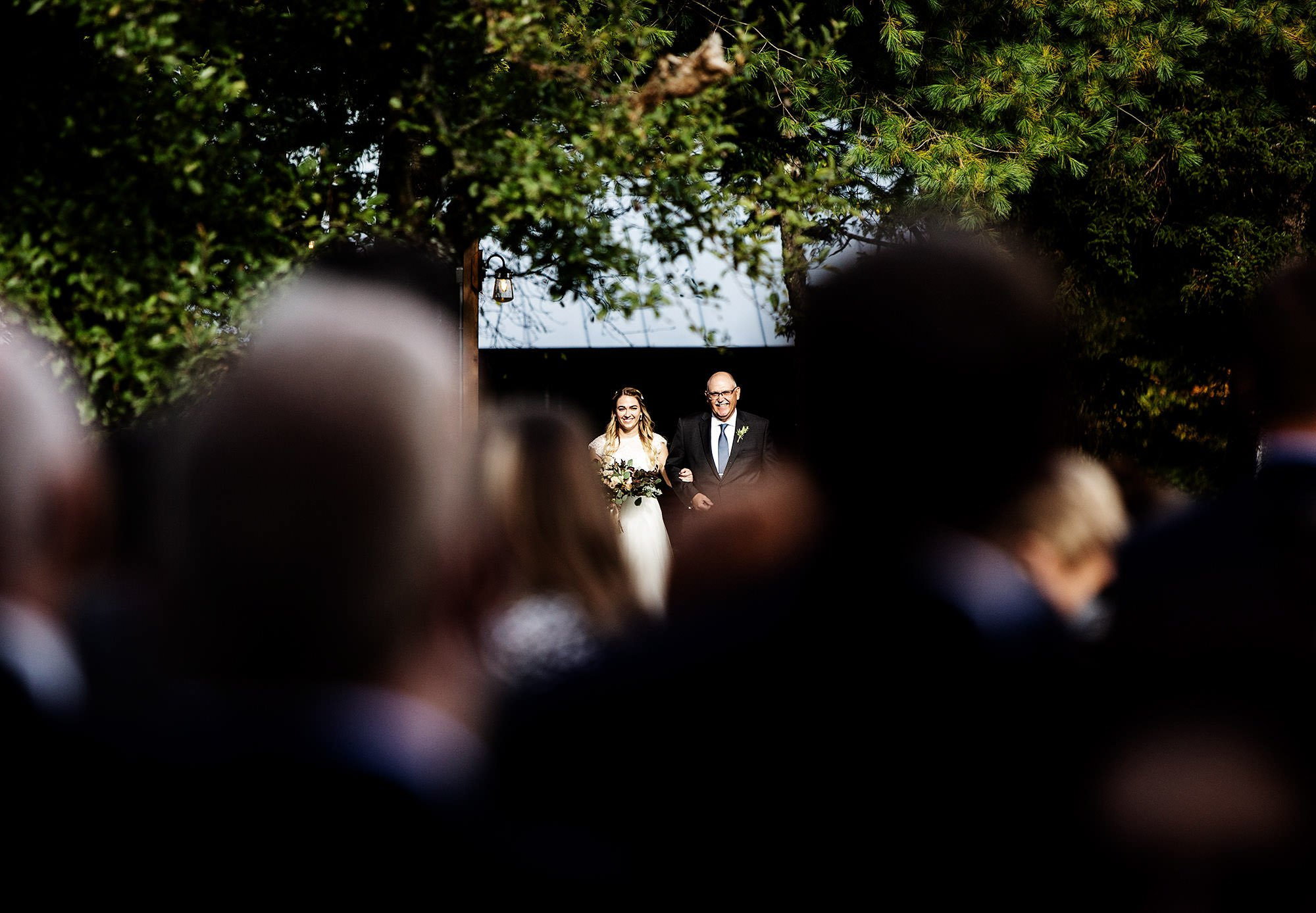 The Bride and her father process during the ceremony of their Mad River Barn Wedding.