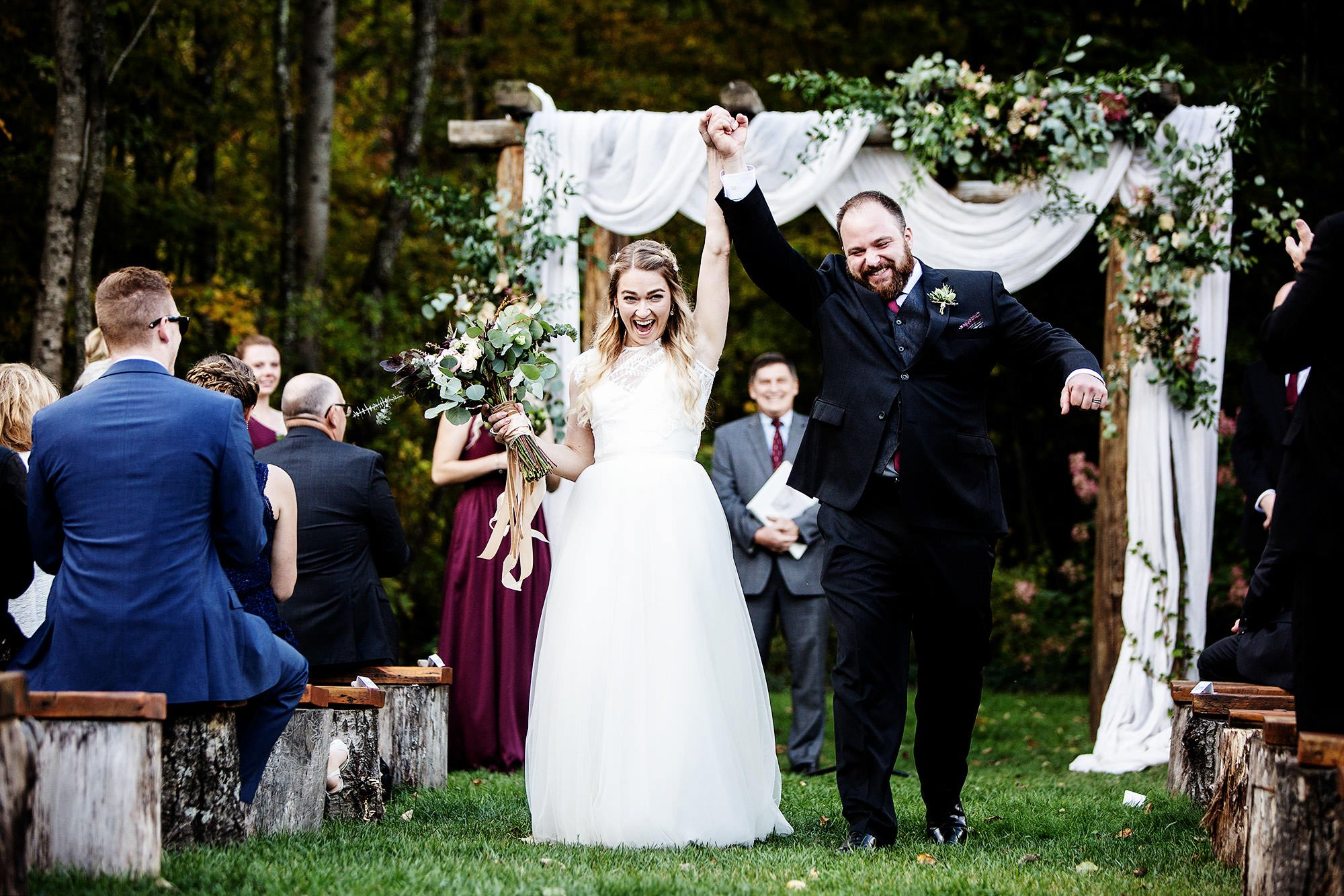 The bride and groom cheer following their ceremony at Mad River Barn Wedding in Waitsfield, VT.