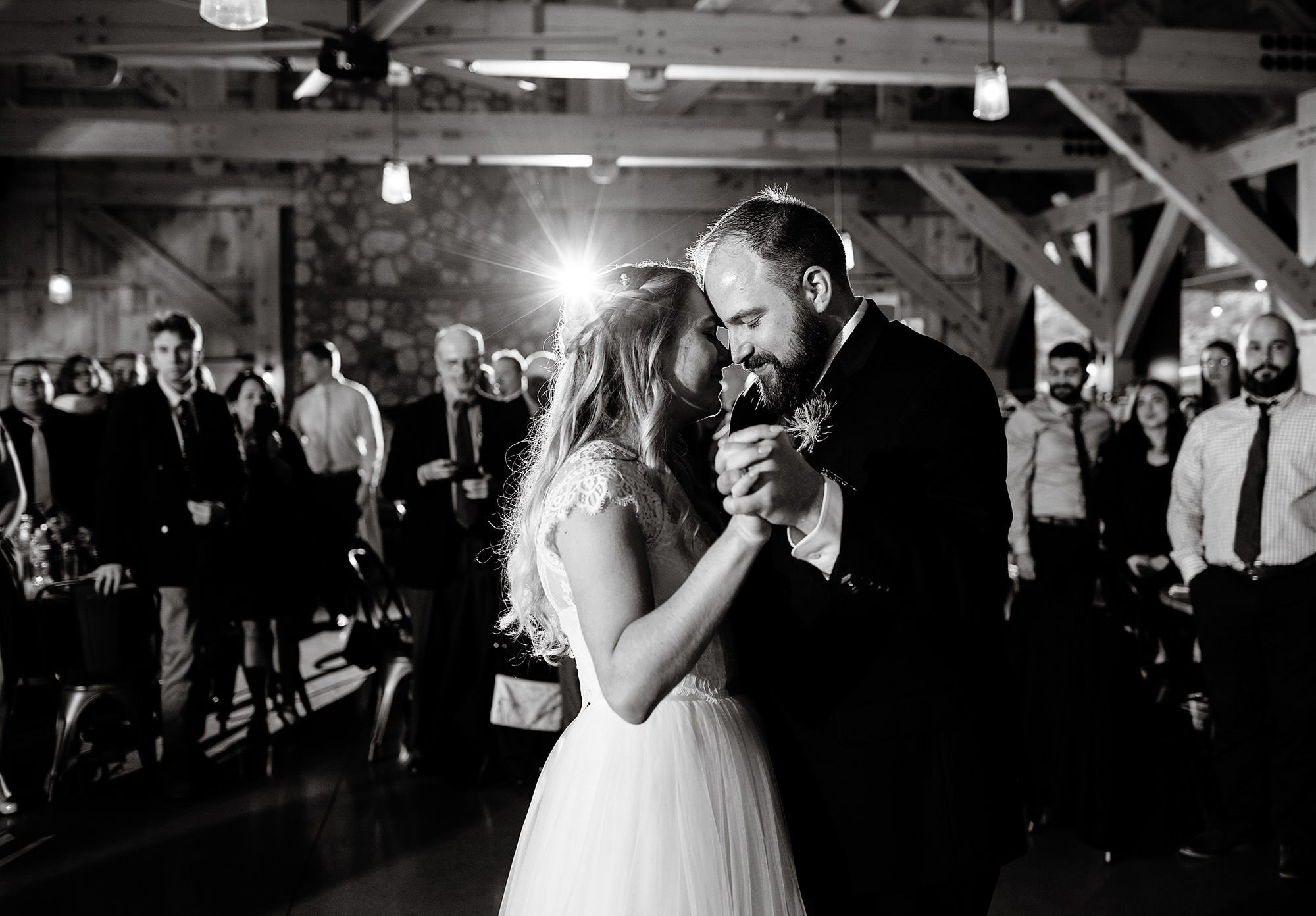 The bride and groom share their first dance during their Mad River Barn wedding reception.