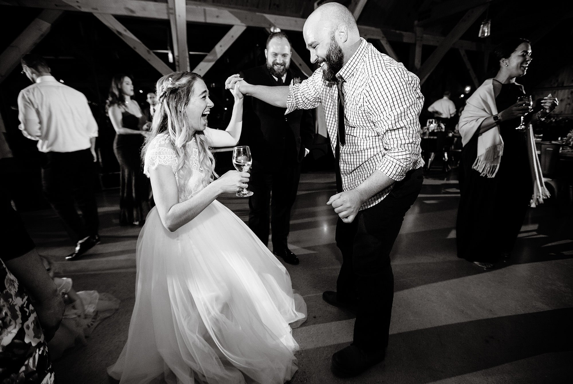 The bride dances with her guests during her Mad River Barn wedding.