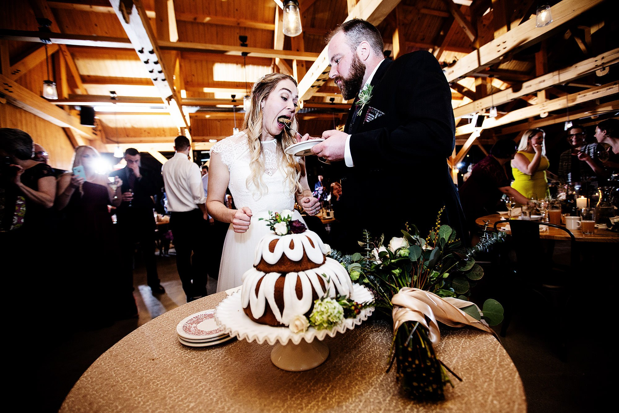 The bride and groom cut the cake at Mad River Barn.