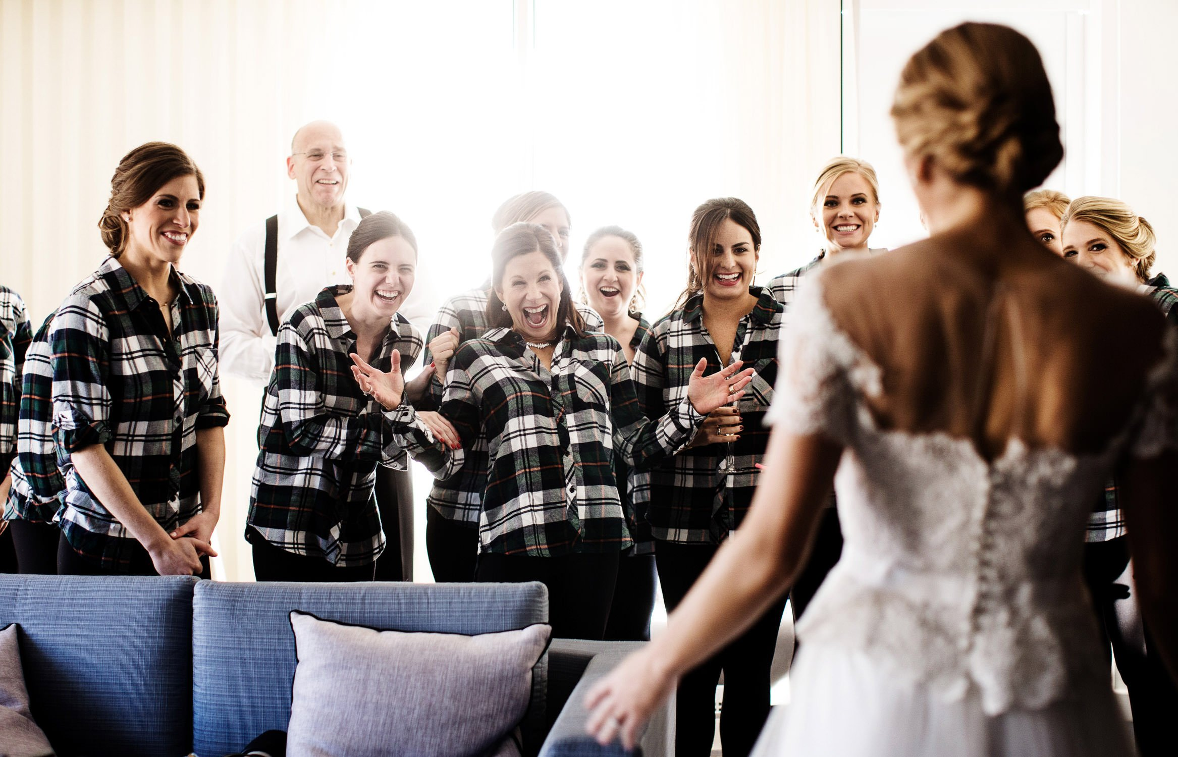 The bride is greeted by her bridal party at the Willard Hotel in DC.