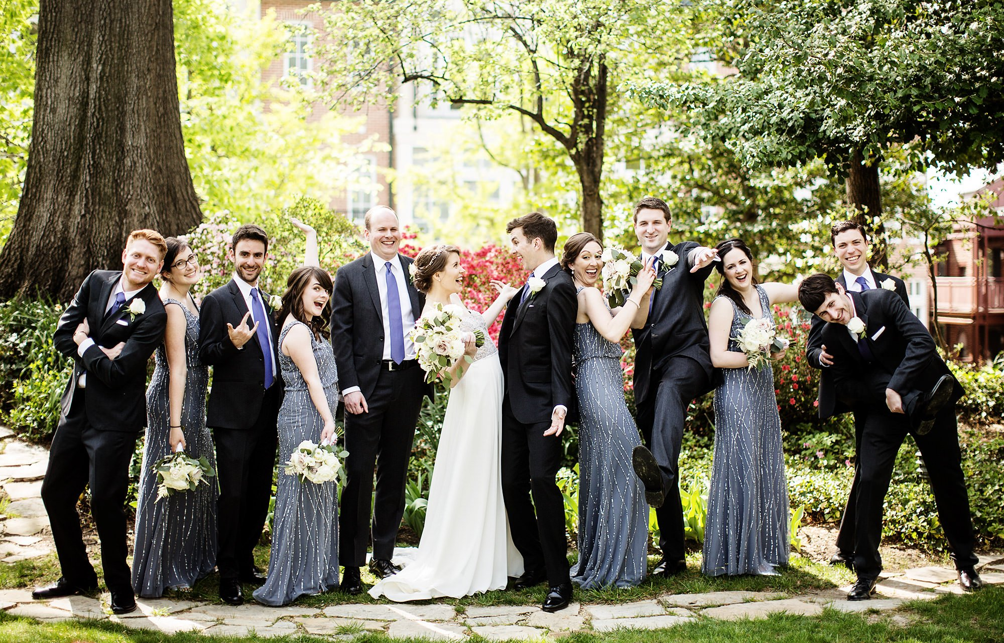 A portrait of the wedding party on the grounds of Meridian House.