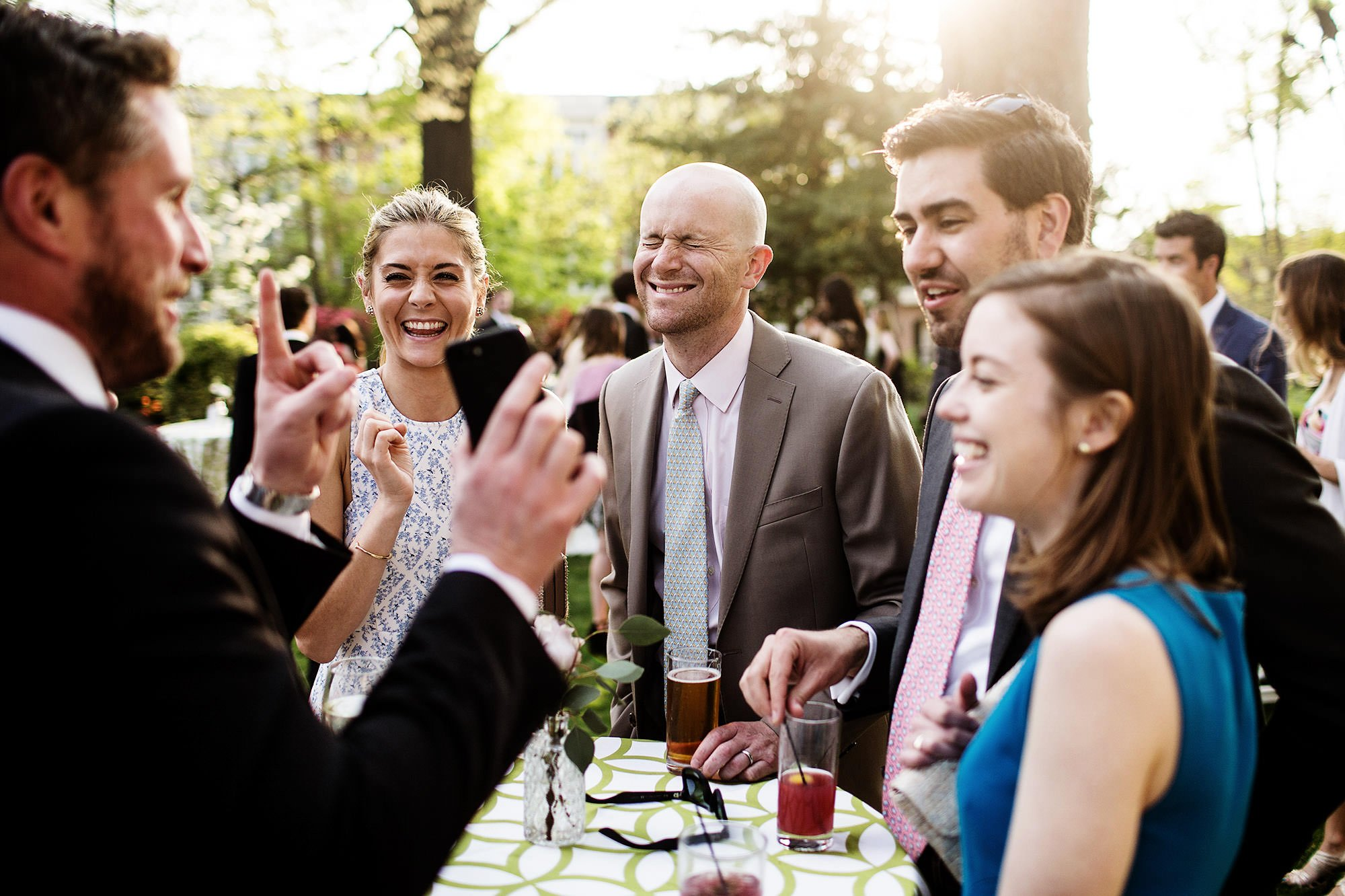Guests laugh during cocktail hour.