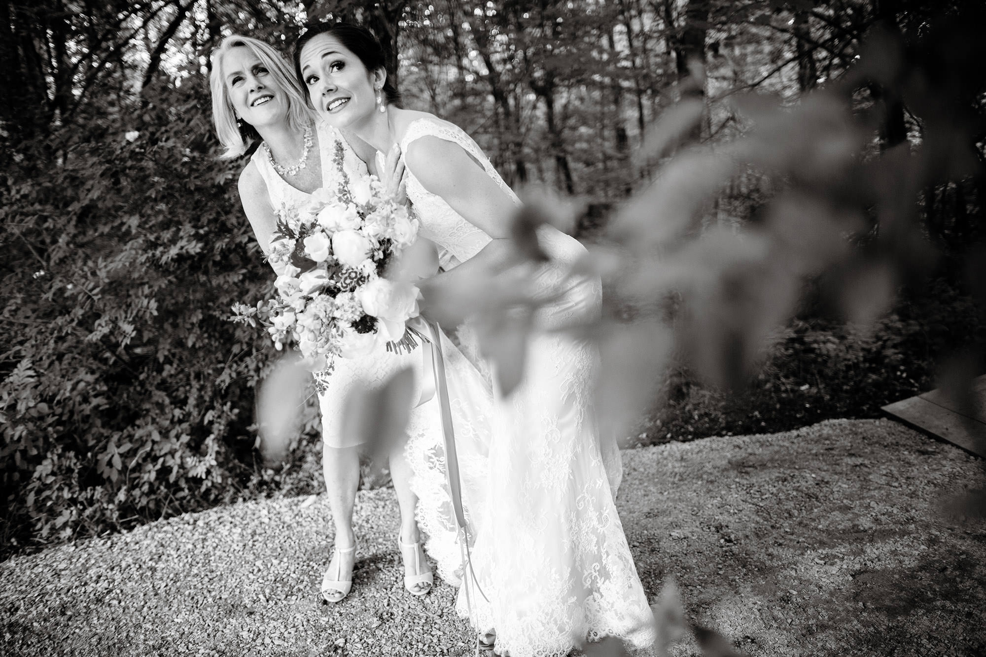 The bride waits with her mother prior to their outdoor wedding ceremony.