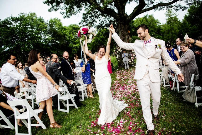The bride and groom celebrate following their ceremony during their Mesa Farm Wedding in Rutland, MA