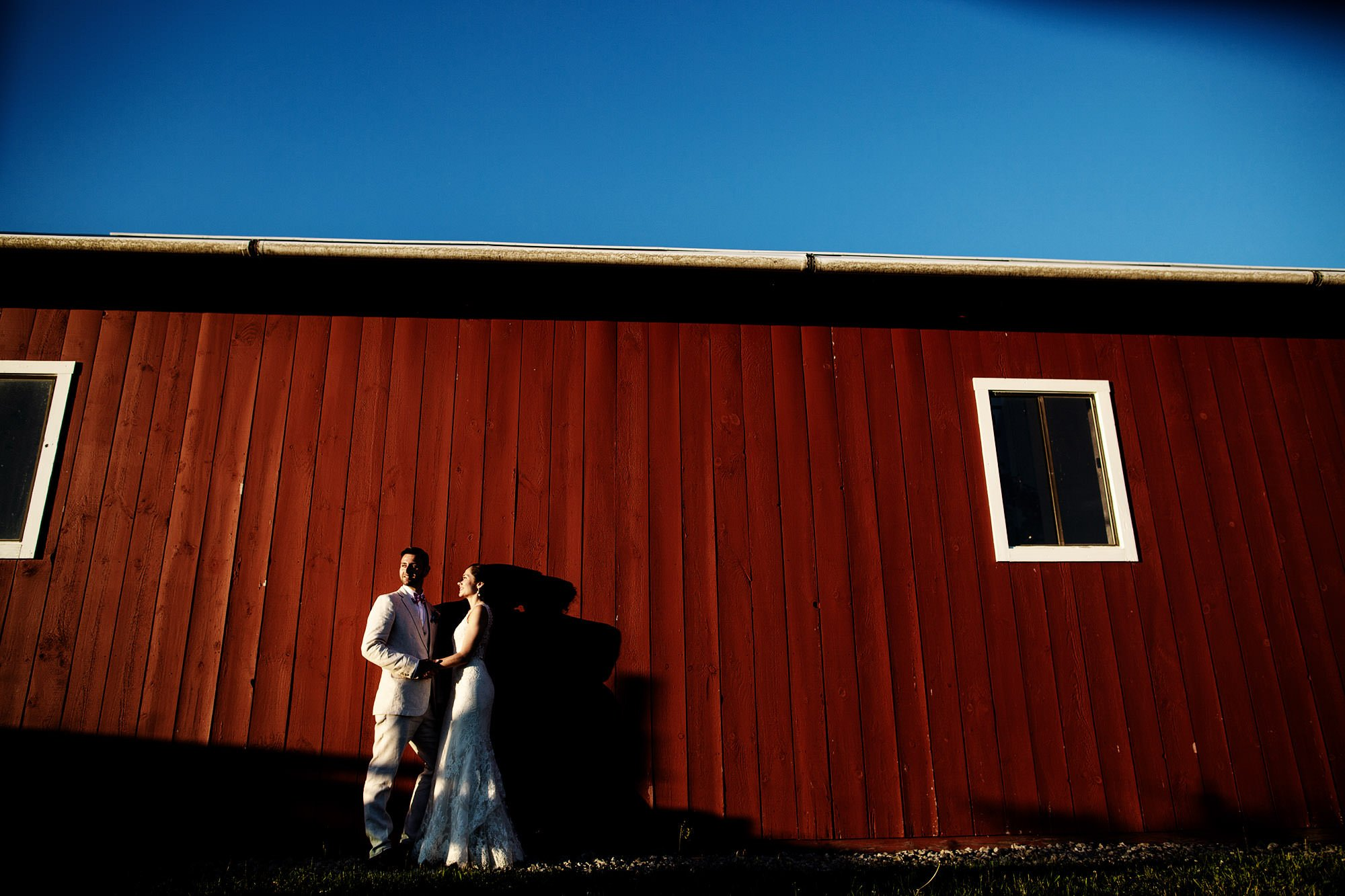 The bride and groom pose for a portrait at Mesa Farm.