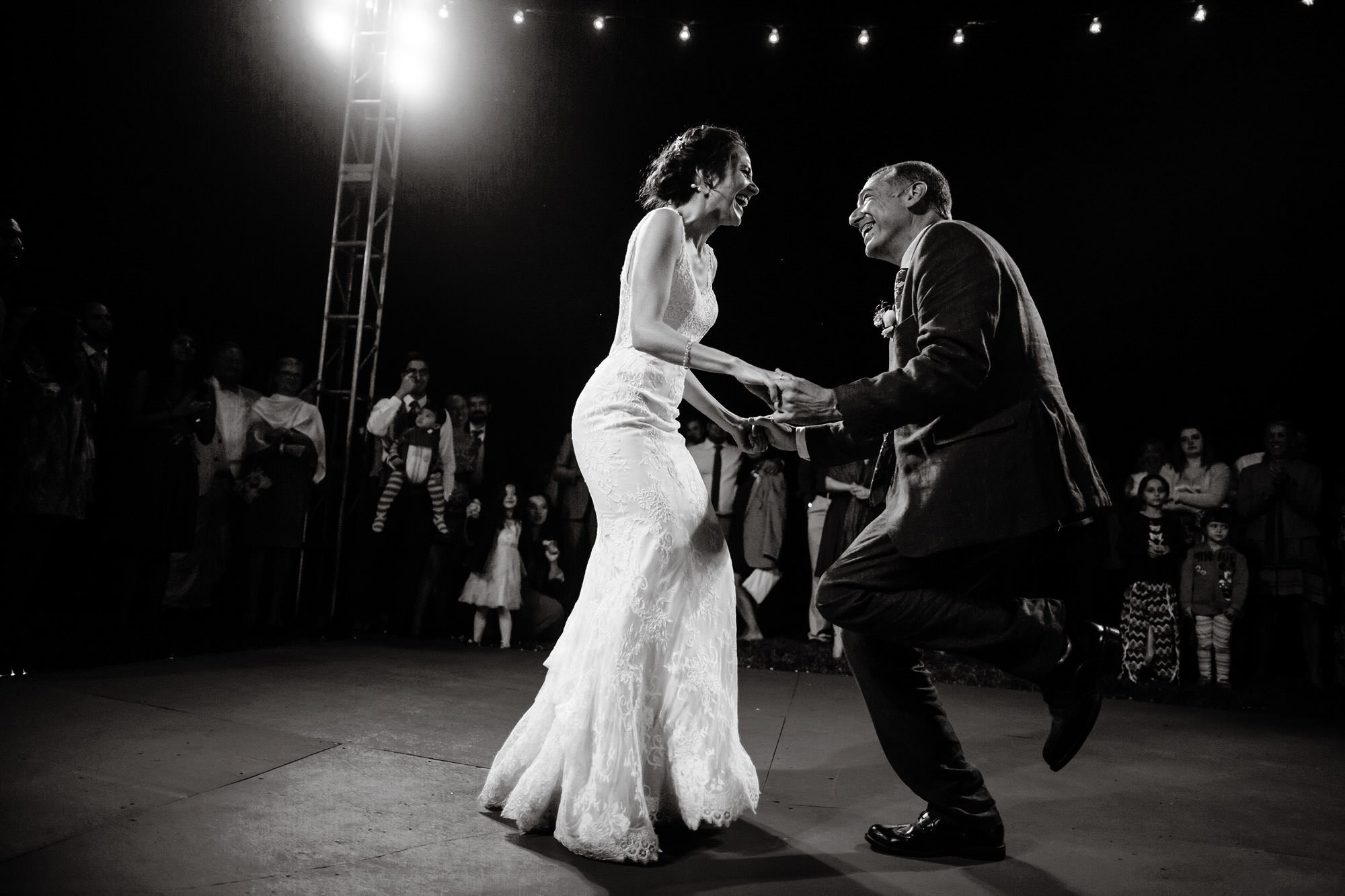 The bride and her father dance together during this outdoor reception during their Mesa Farm Wedding.