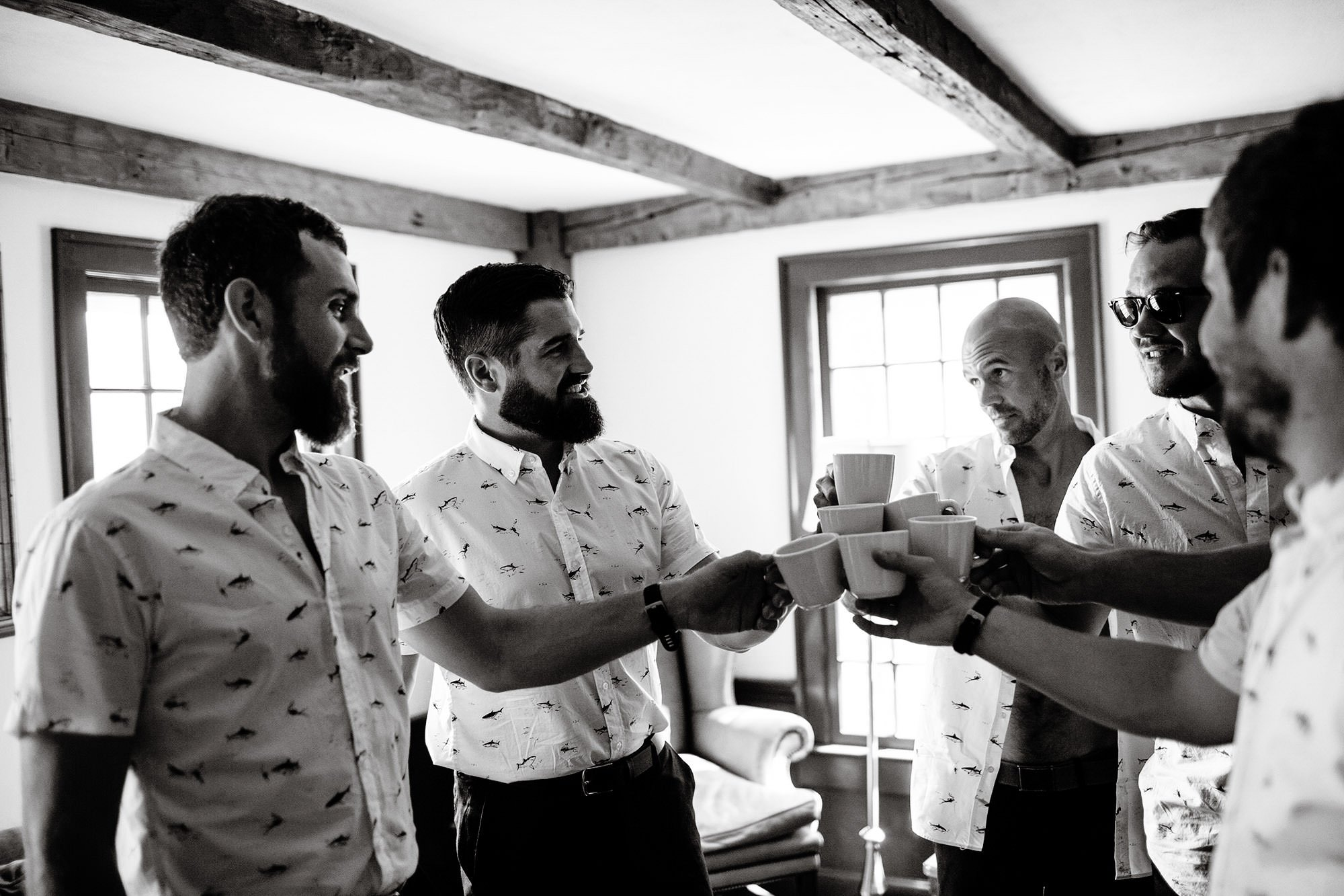 Groomsman toast before ceremony at Mount Hope Farm.