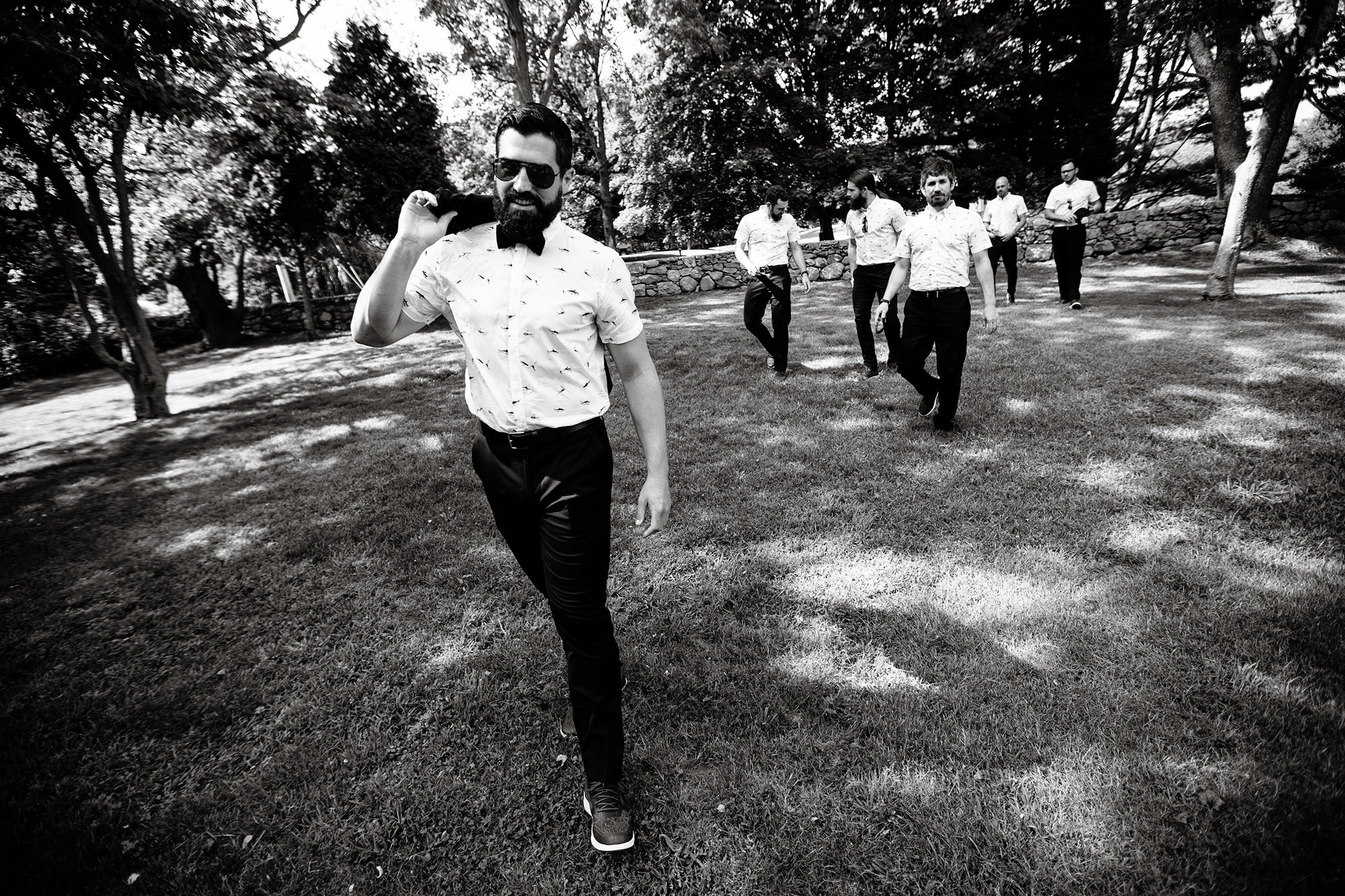Before the Mount Hope Farm Wedding, the groomsmen stroll around the grounds.