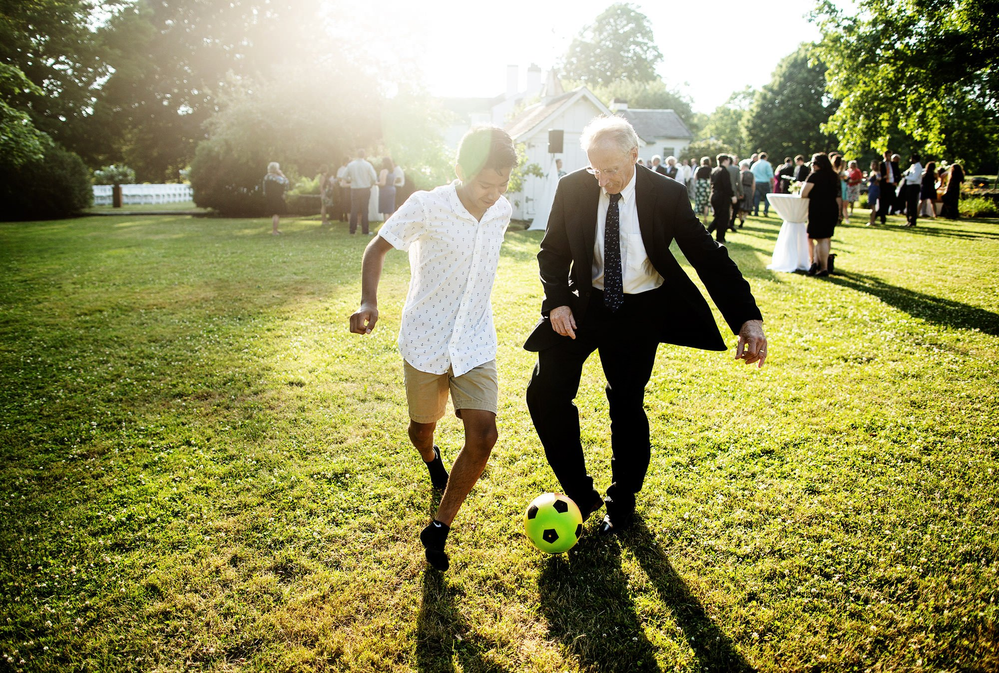 Guests play soccer during cocktail hour at Mount Hope Farm.