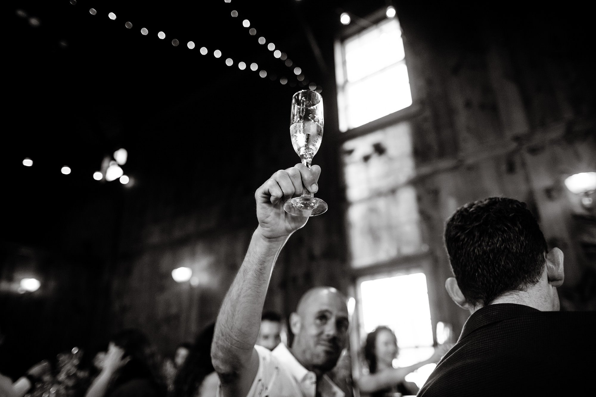 Guests toast to the bride and groom during this Mount Hope Farm wedding.
